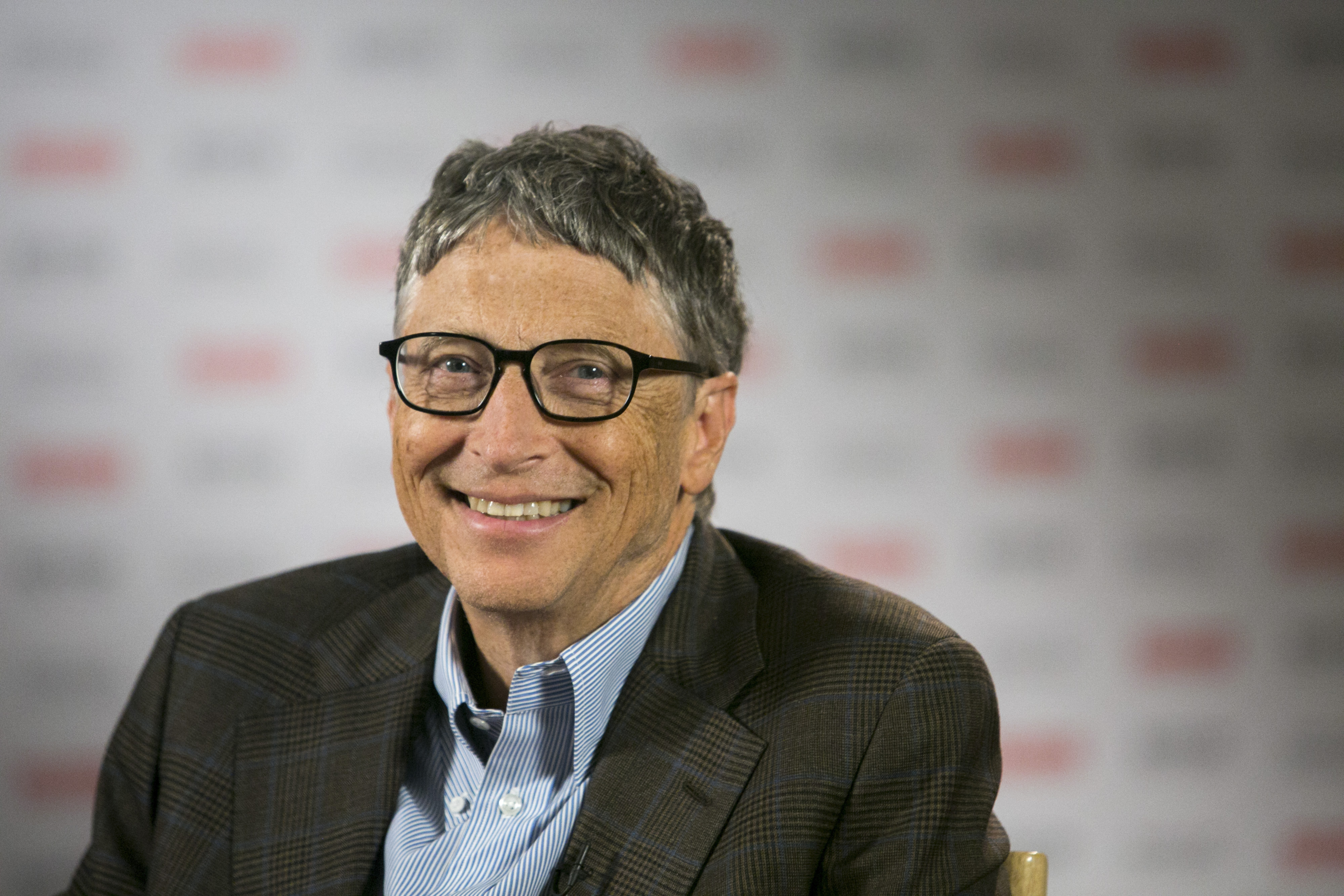 Billionaire Bill Gates, co-founder of Microsoft and co-chair of the Bill and Melinda Gates Foundation, smiles before an interview with Bloomberg Television at the Sibos financial services conference in Boston, Mass. on Oct. 2, 2014.
