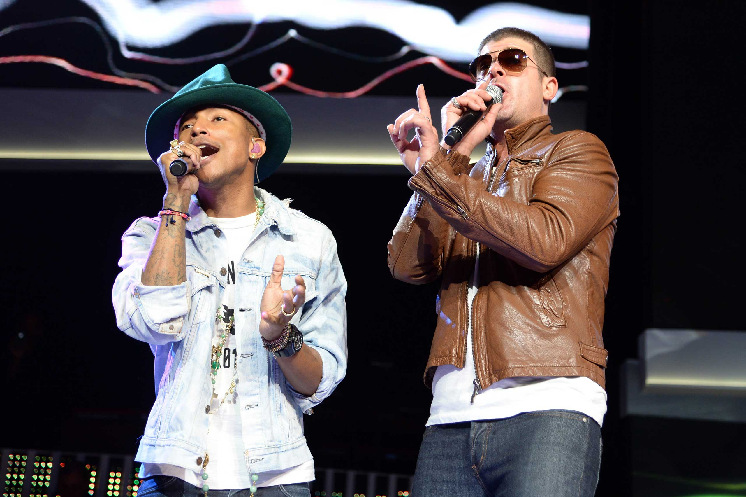 Pharrell Williams and Robin Thicke perform during the Walmart 2014 annual shareholders meeting at Bud Walton Arena at the University of Arkansas in Fayetteville, Ark. on June 6, 2014