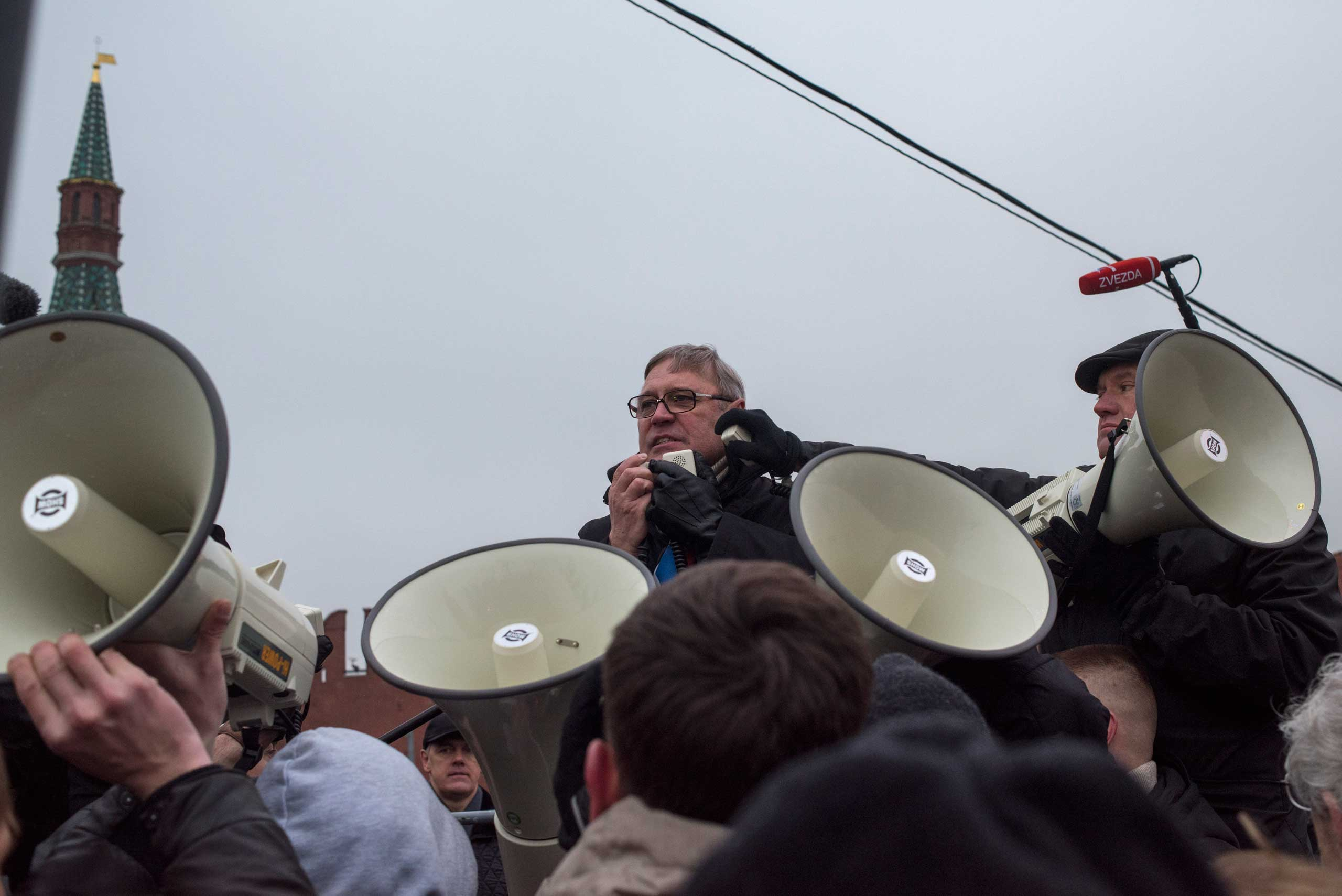 Former Russian Prime Minister Mikhail Kasyanov pays tribute to Boris Nemtsov during the march in Moscow on March 1, 2015.