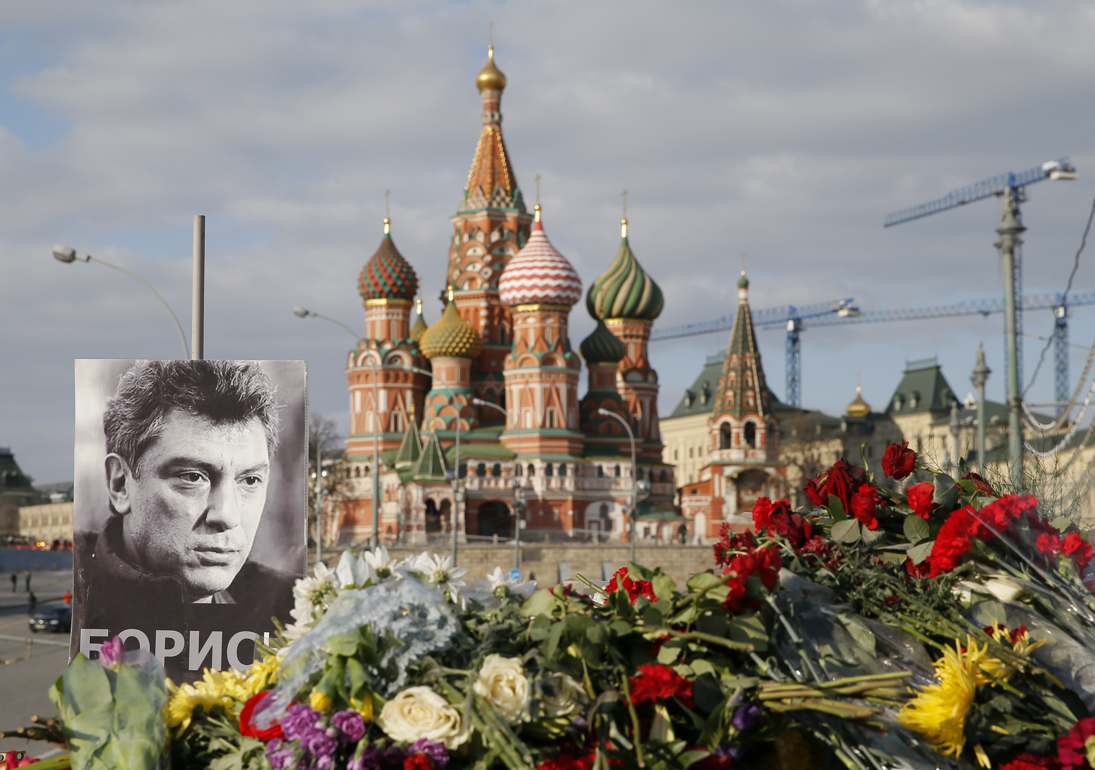 A portrait of Kremlin critic Boris Nemtsov and flowers are pictured at the site where he was killed on Feb. 27, 2015 with St. Basil's Cathedral seen in the background, at the Great Moskvoretsky Bridge in central Moscow on March 6, 2015.