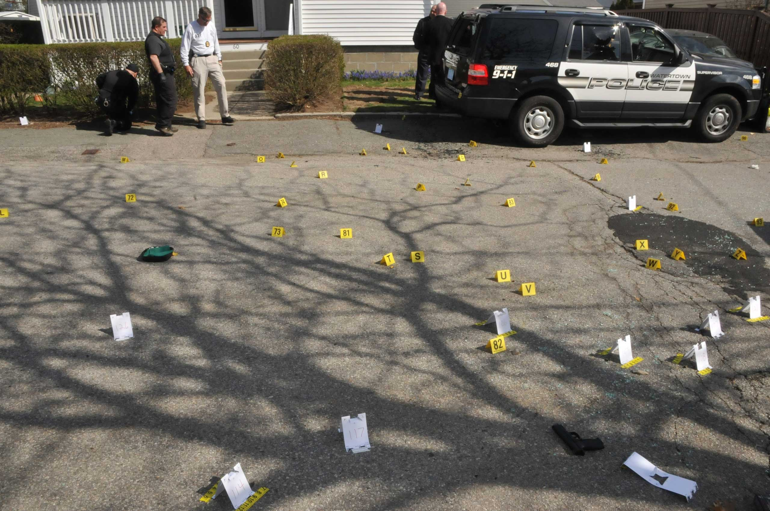 Evidence markers are seen on a street where Tamerlan and Dzhokhar Tsarnaev engaged in a gunfight with police.