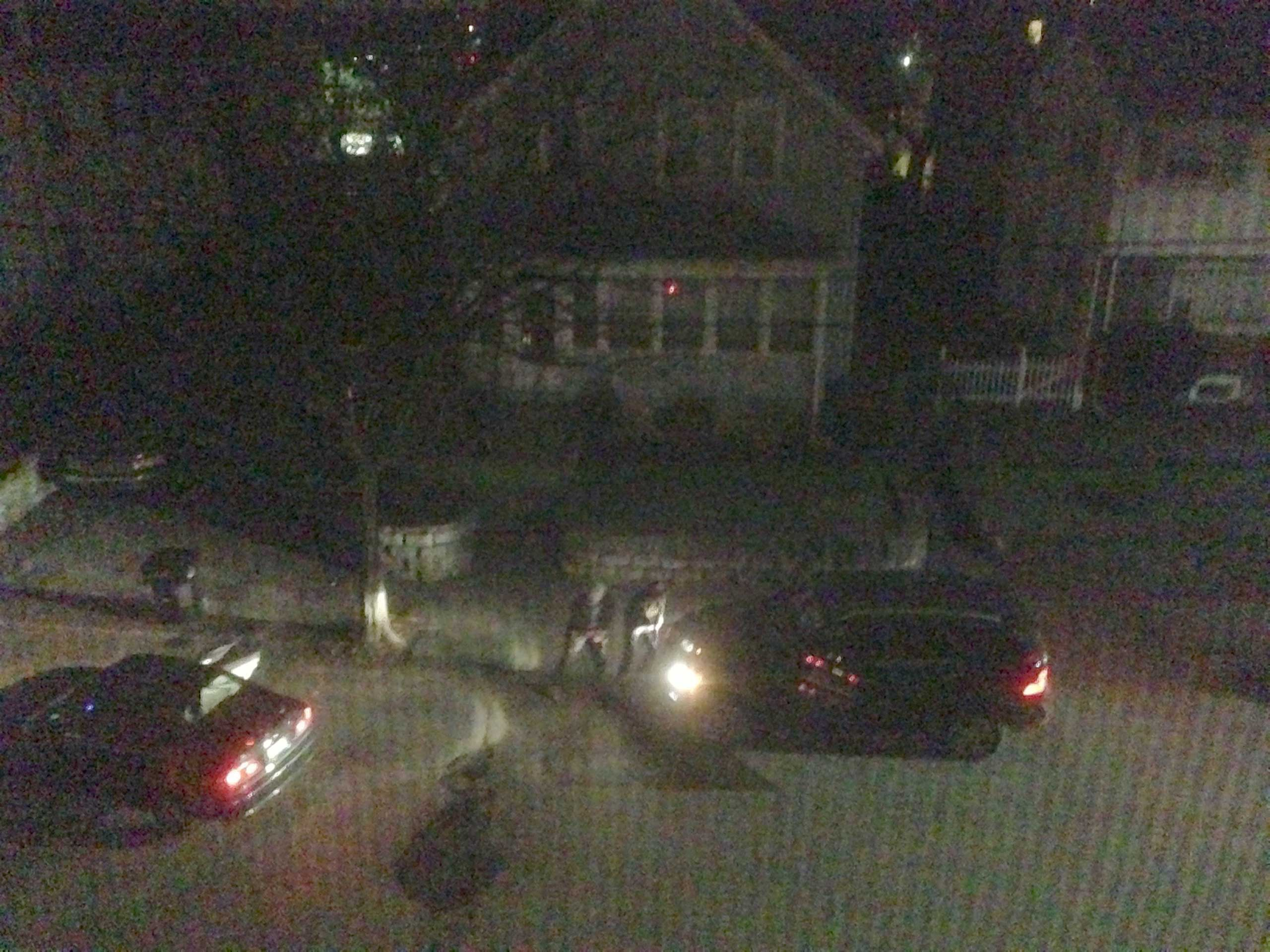 This still image captured from video shows brothers Tamerlan and Dzhokhar Tsarnaev crouched behind a car during their April 2013 shootout with police.