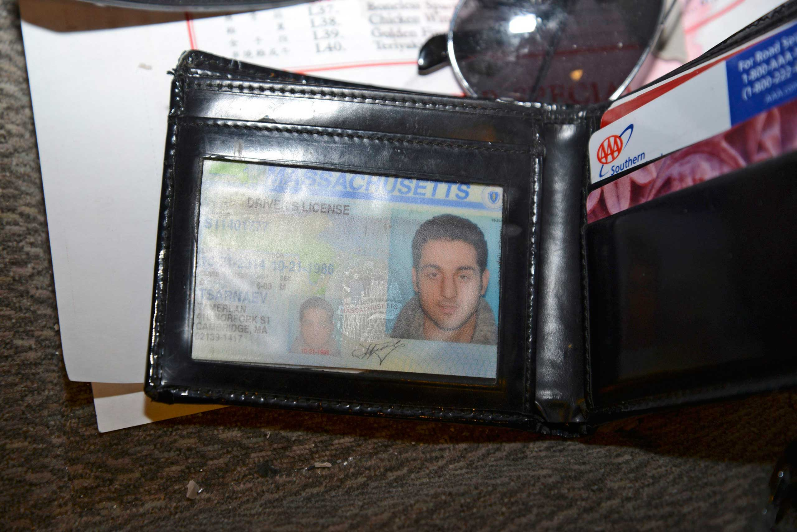 A wallet containing Tamerlan Tsarnaev's drivers license is seen in a still handout image entered as evidence in the trial of Boston Marathon bombing suspect Dzhokhar Tsarnaev.