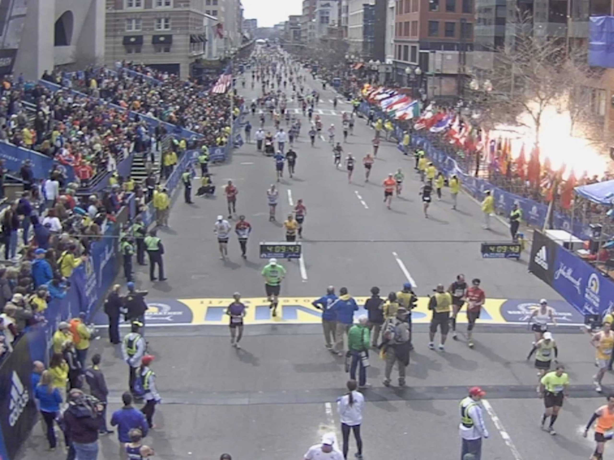 This still image capture from video, which was released as evidence in the trial of Dzhokhar Tsarnaev, shows the chaos as a bomb explodes during the 2013 Boston Marathon.