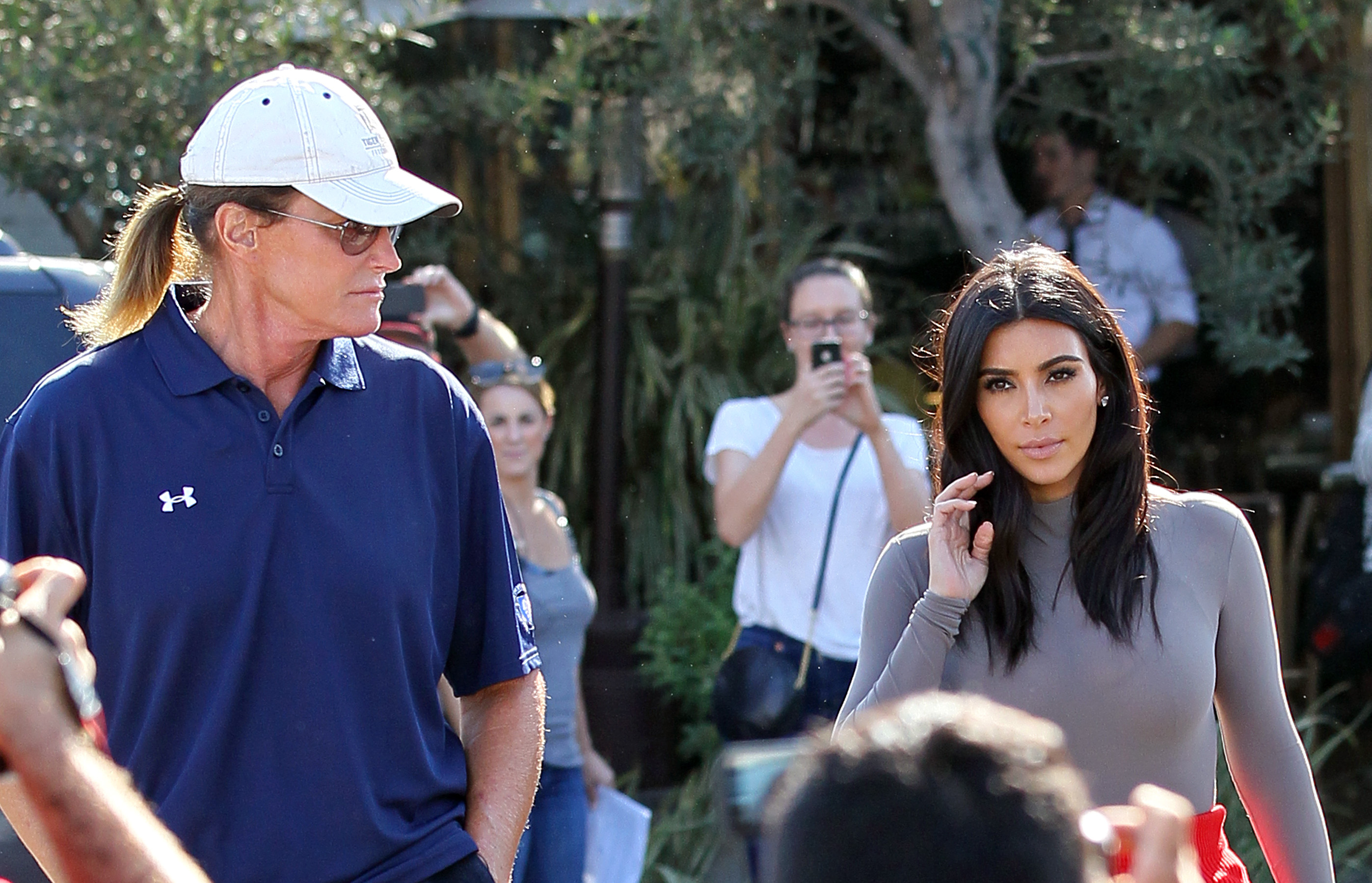 Bruce Jenner and Kim Kardashian are seen filming their reality show in Los Angeles on Oct. 20, 2014.