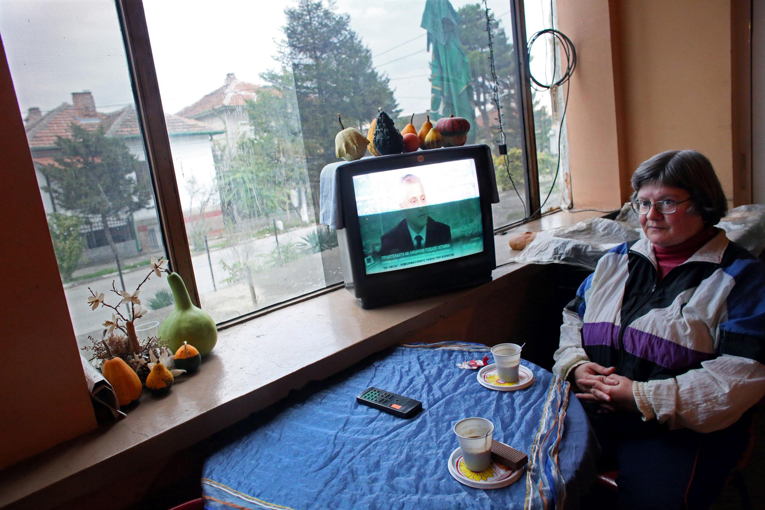 Veselka Vasileva sits at a grocery store in Sinagovtsi, Bulgaria, Oct. 22, 2014.