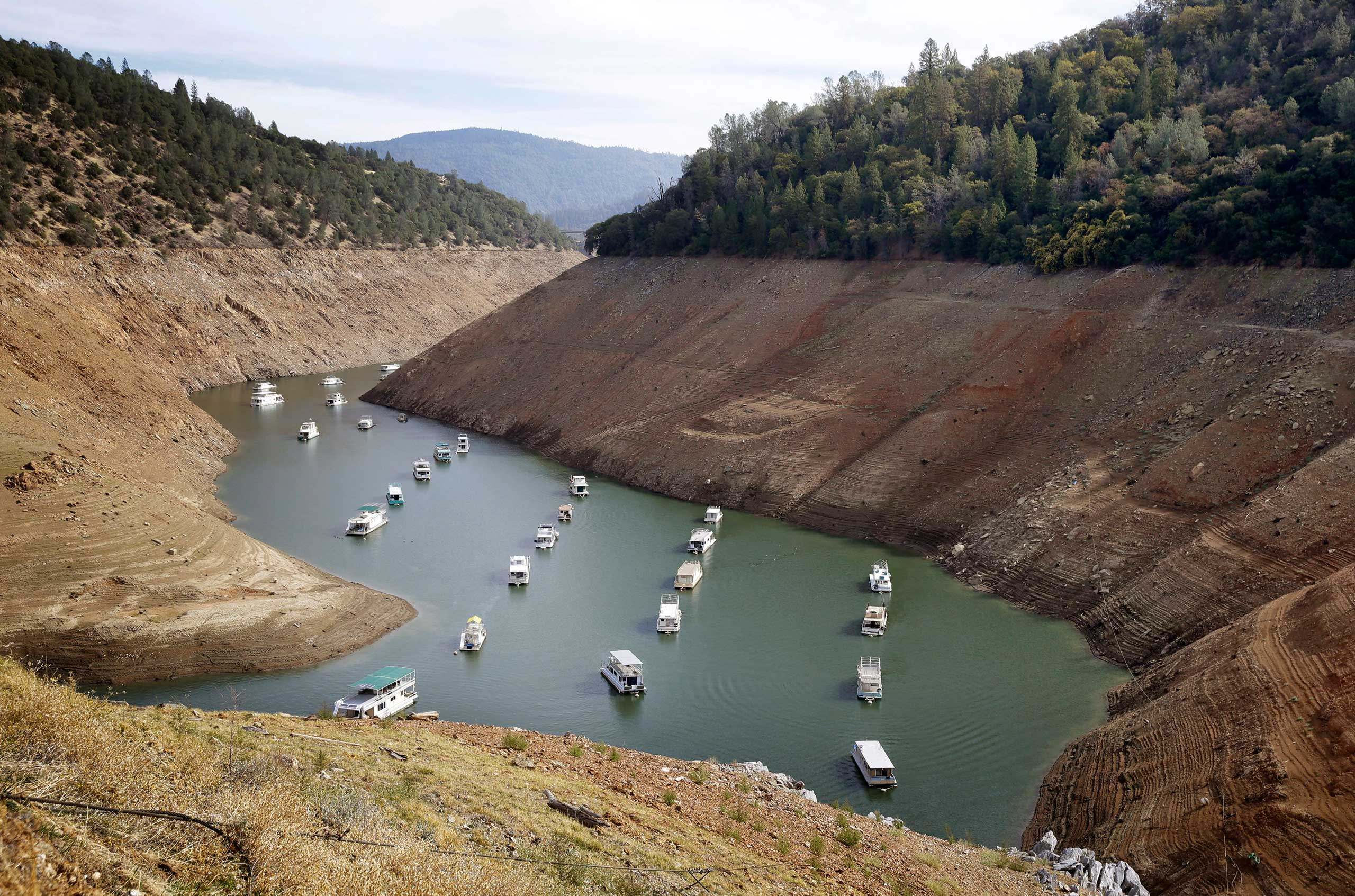 Houseboats sit in the drought lowered waters of Oroville Lake, near Oroville, Calif. in 2014.