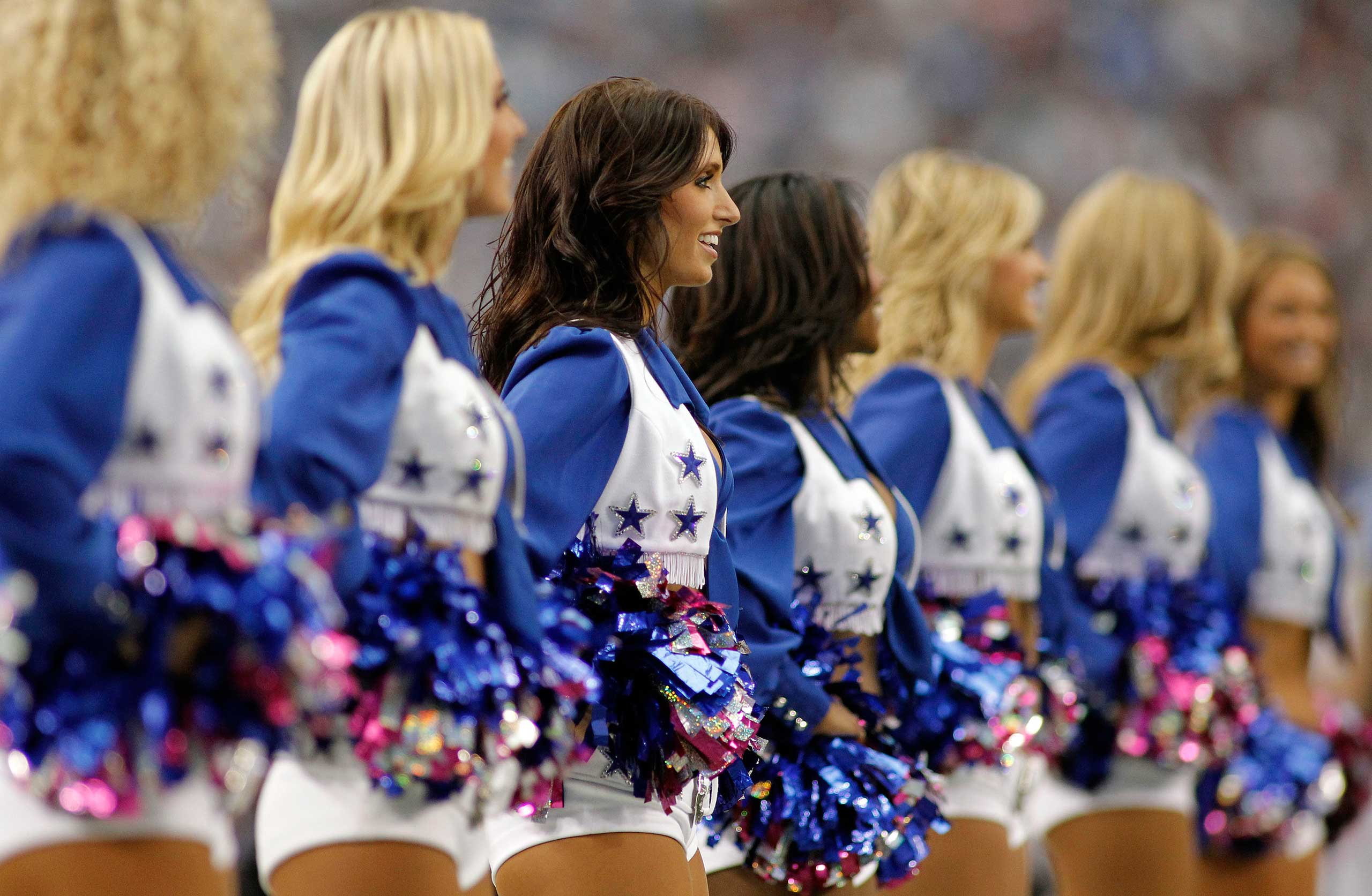 The Dallas Cowboys cheerleaders perform during the game between the Cowboys and Detroit Lions at Cowboys Stadium in Arlington, Texas.
