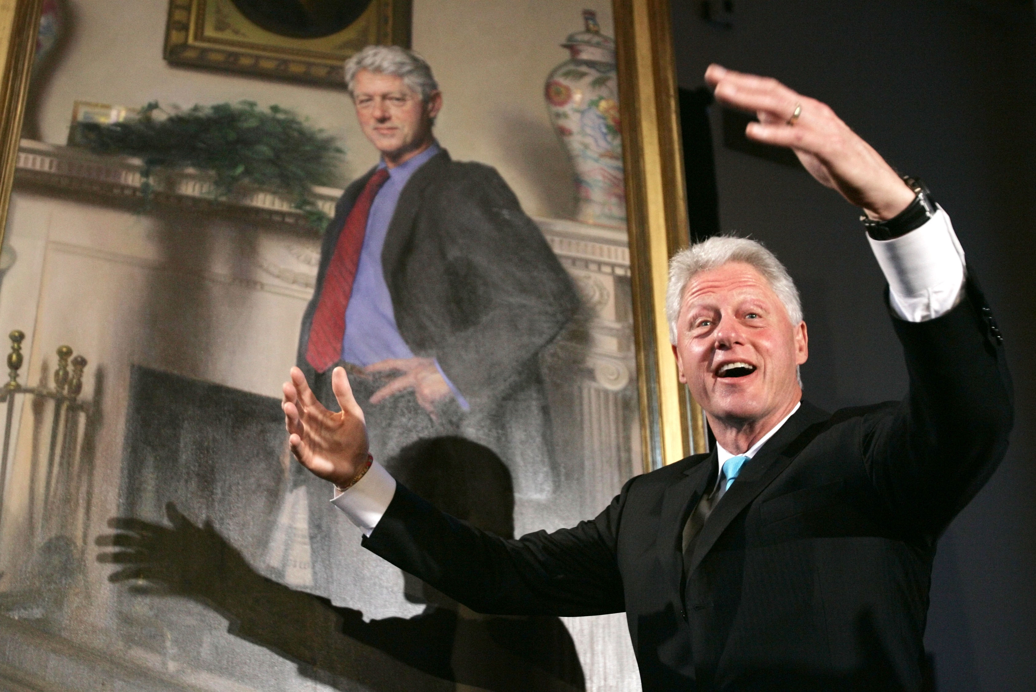 Former President Bill Clinton gestures after the portraits of his wife, Hillary Rodham Clinton and him, were revealed on April 24, 2006, at the Smithsonian Castle Building in Washington, D.C.
