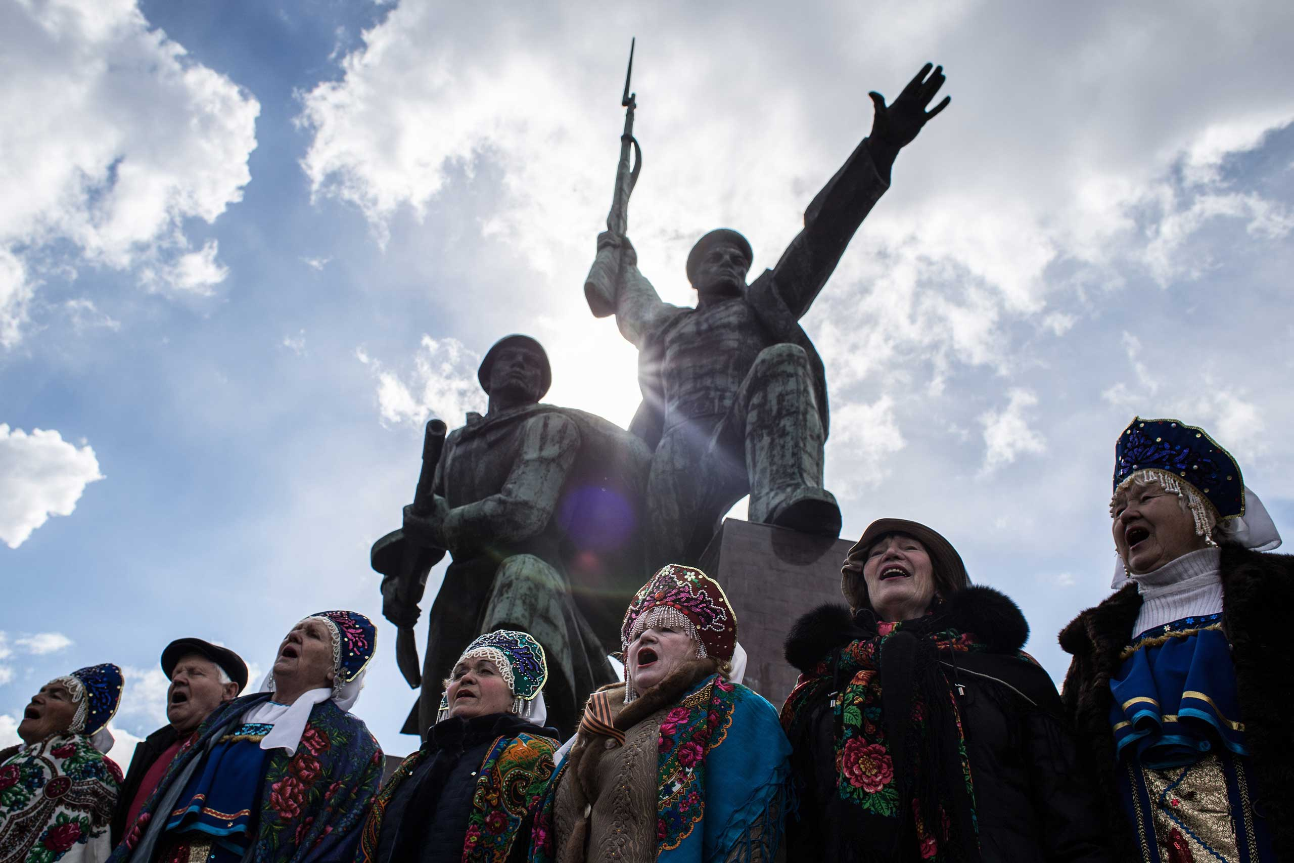 People sing on the first anniversary of the annexation to Russia, March 18, 2015 in Sevastopol.