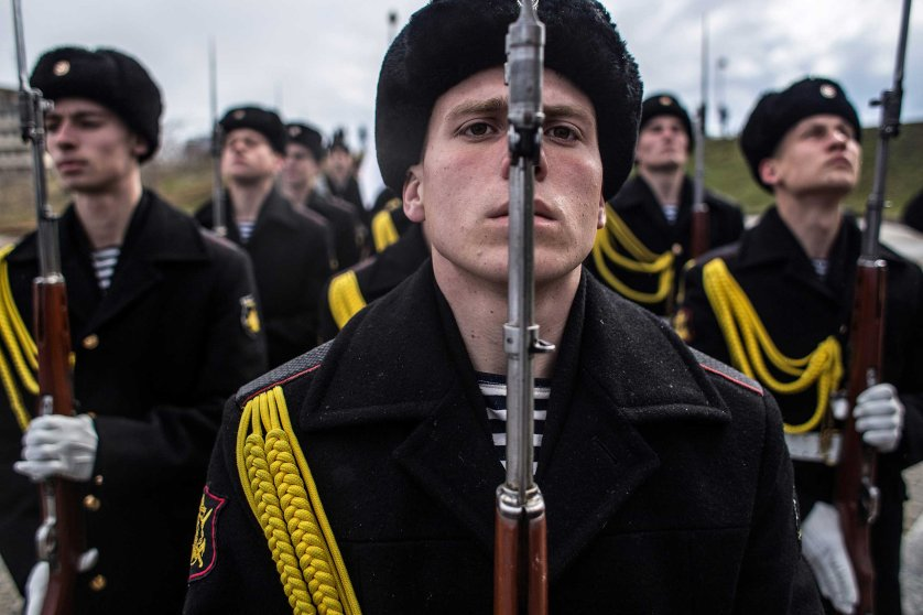 Soldiers of the honor guard prepare to march as people celebrate the first anniversary of the signing of the decree on the annexation of the Crimea by the Russian Federation, on March 18, 2014 in Sevastopol, Crimea.