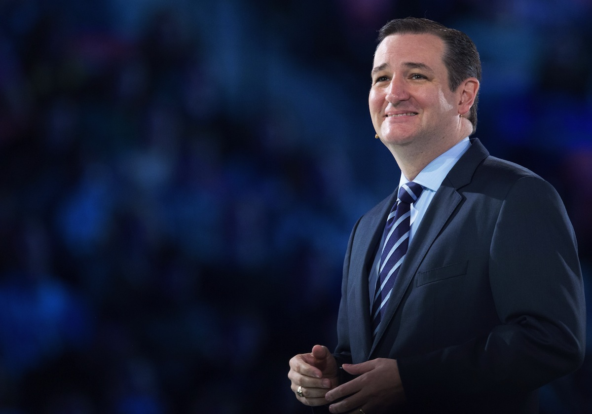 US Senator Ted Cruz( R-TX) smiles at the crowd while delivering remarks announcing his candidacy for the Republican nomination to run for US president March 23, 2015, inside the full Vine Center at Liberty University, in Lynchburg, Va.