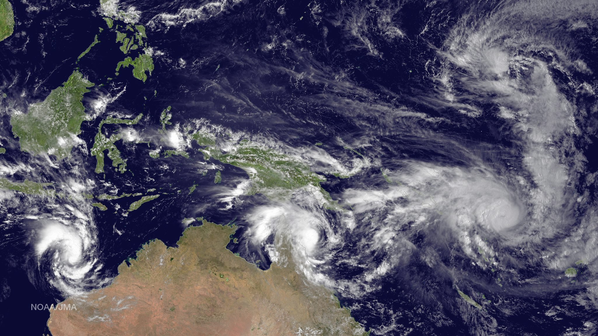 Left to right: Tropical Cyclone Olwyn in the Indian Ocean heading south for landfall near Learmonth on the west coast of Australia, Tropical Cyclone Nathan meanders northeast of Cooktown, Queensland, Australia in the Coral Sea, Tropical Cyclone Pam tracks due south heading for the islands of Vanuatu in the southern Pacific Ocean and Tropical Depression 3 heads west-northwest towards Guam in the northern Pacific Ocean on March 11, 2015.