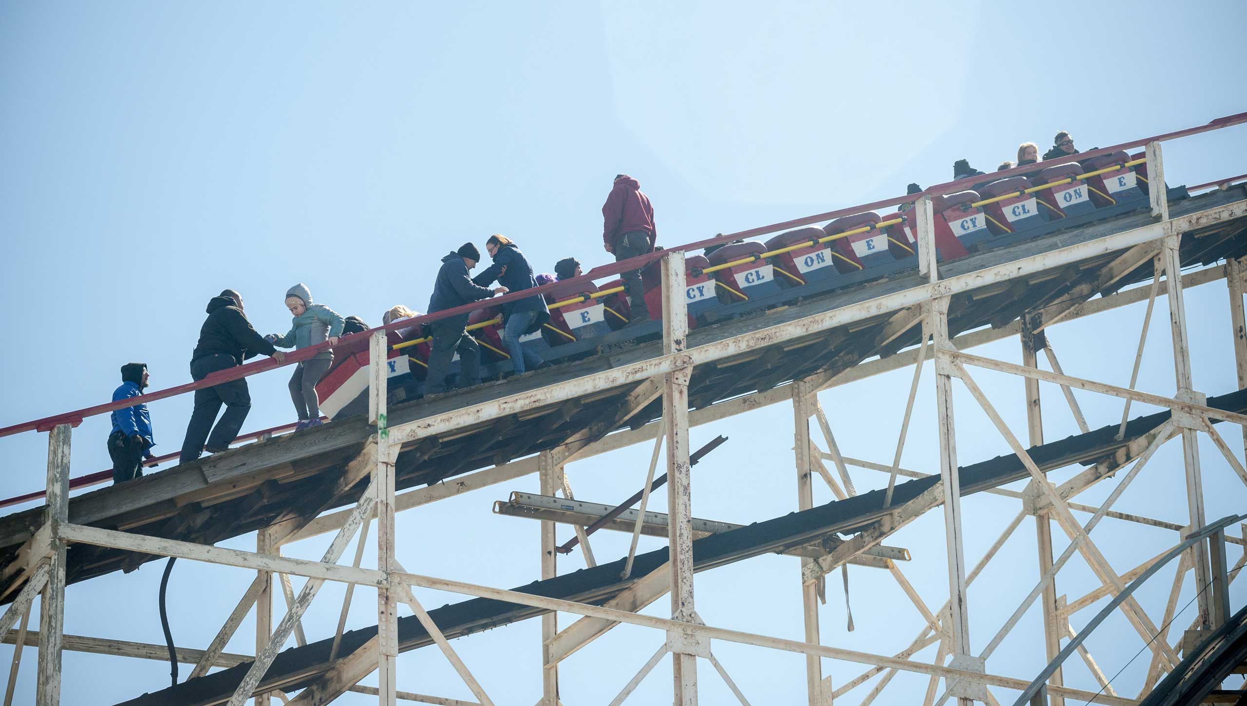 Workers assist thrill seekers on the Luna Park Coney Island Cyclone roller coaster after it got stuck on its inaugural run of the Summer 2015 season, on March 29, 2015 in Brooklyn, N.Y.