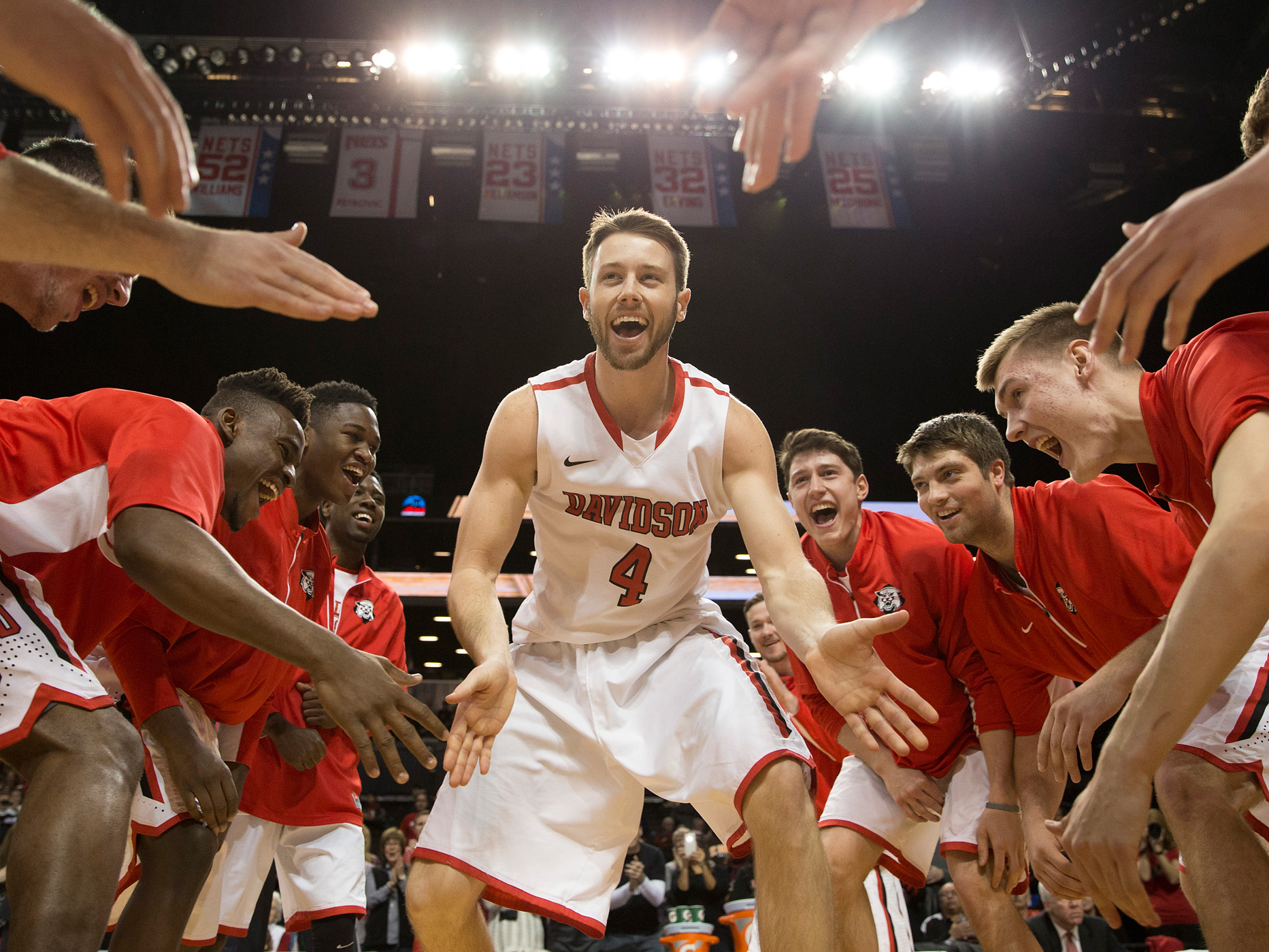 Tyler Kalinoski #4 of the Davidson Wildcats walks on the court during the introductions prior to the game against the La Salle Explorers in the quarterfinals of the men's Atlantic 10 tournament on March 13, 2015 at the Barclays Center in Brooklyn in New York City.