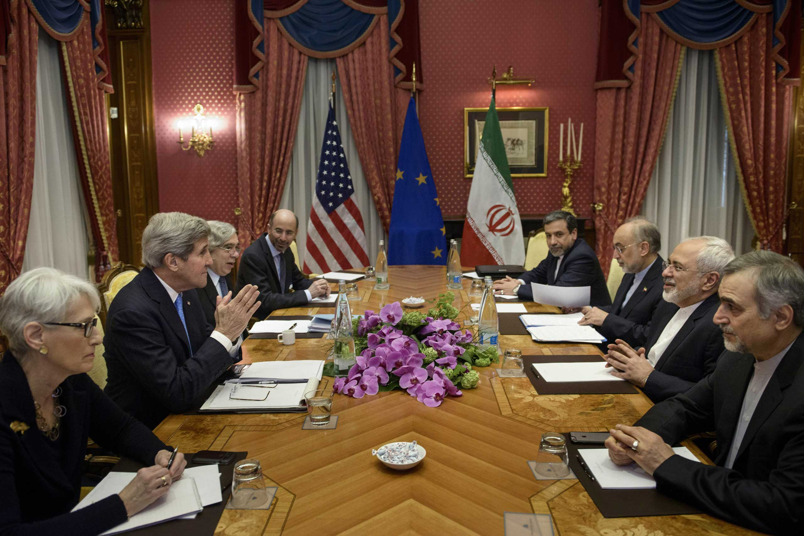 From left, U.S. Under Secretary for Political Affairs Wendy Sherman, U.S. Secretary of State John Kerry, U.S. Secretary of Energy Ernest Moniz, Robert Malley, member of the U.S. National Security Council, Iranian Deputy Foreign Minister Abbas Araghchi, Head of Iran Atomic Energy Organization Ali Akbar Salehi, Iranian Foreign Minister Javad Zarif and Hossein Fereydoon, special assistant to Iranian president, wait to start a meeting at the Beau Rivage Palace Hotel in Lausanne, Switzerland, March 29, 2015.