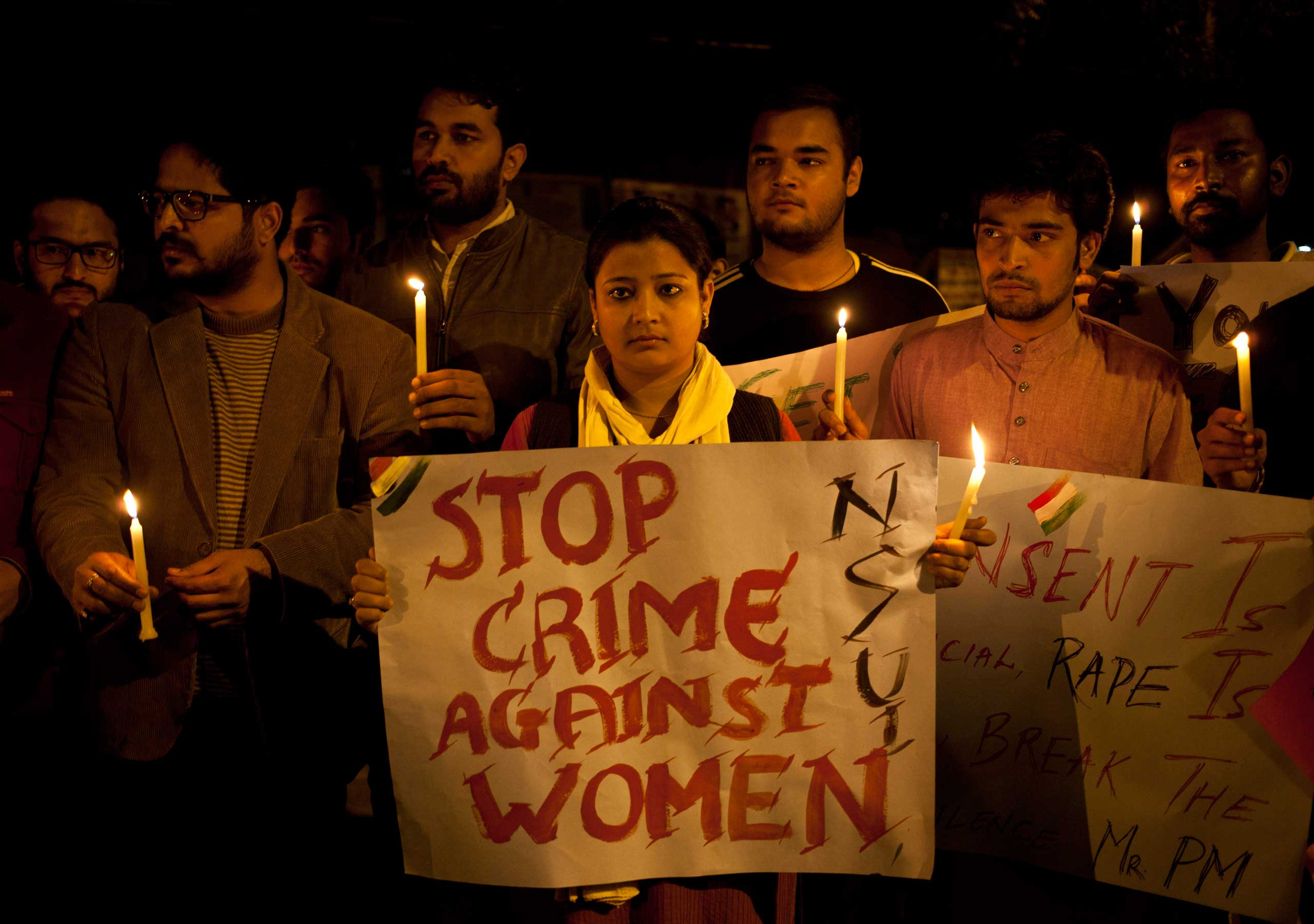 Indian youth hold candles during a protest against sexual violence in New Delhi, India on Feb. 9, 2015.
