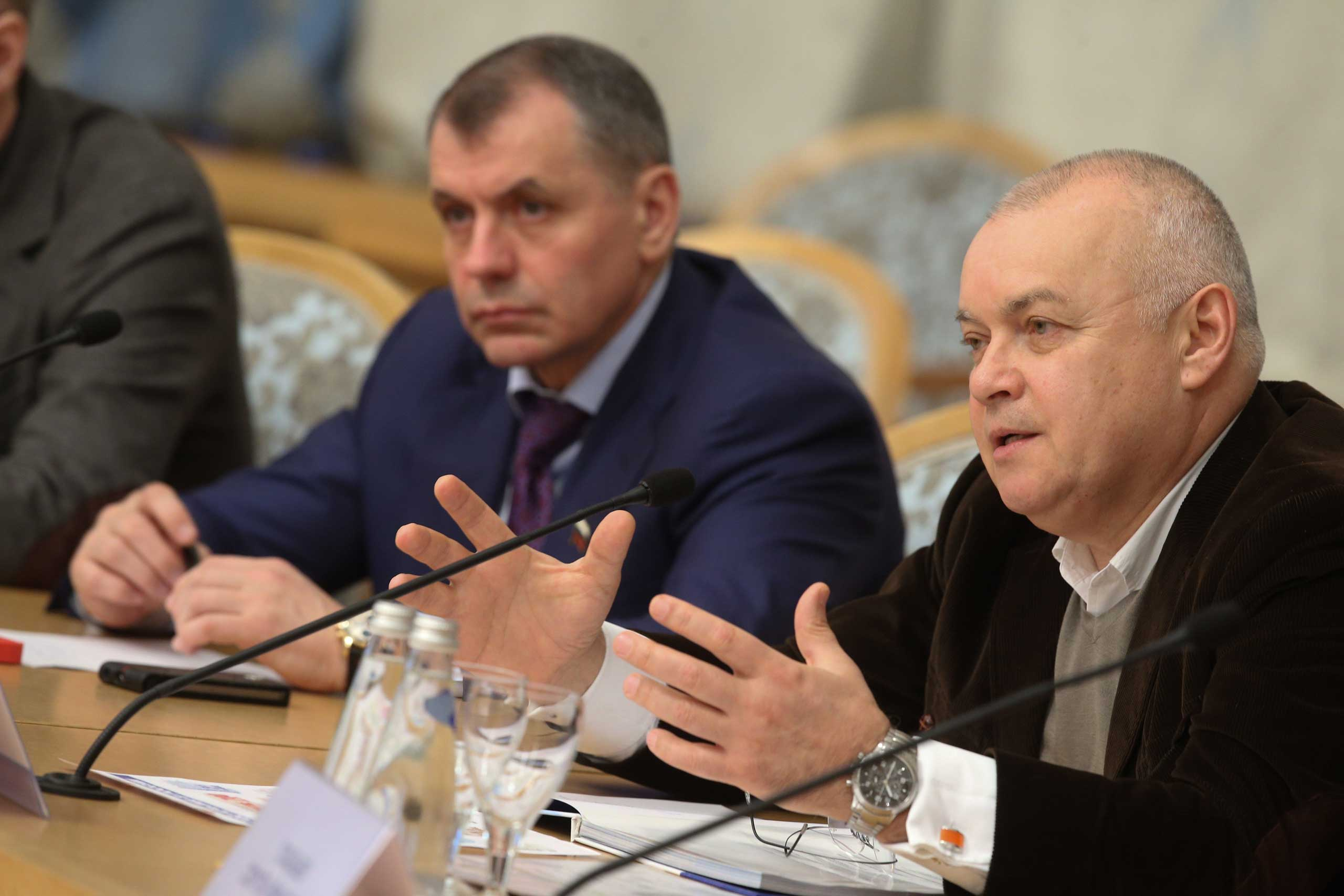 Dmitri Kiselyov, who runs the Kremlin's media conglomerate, Rossiya Segodnya, attends a round table discussion dedicated to the first anniversary of the reunification of Crimea with the Russian Federation at Moscow's President Hotel, March 19, 2015.