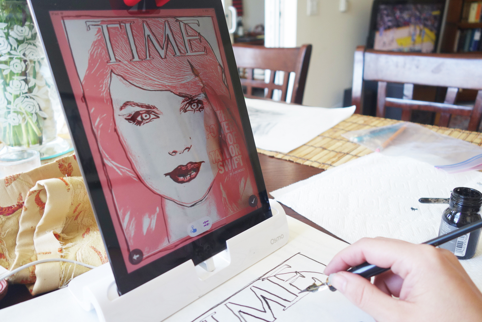 Osmo's Masterpiece app breaks down images into lines that the user can trace, watching their own hand move across the physical page on the tablet's screen. Photo by Katy Steinmetz for TIME