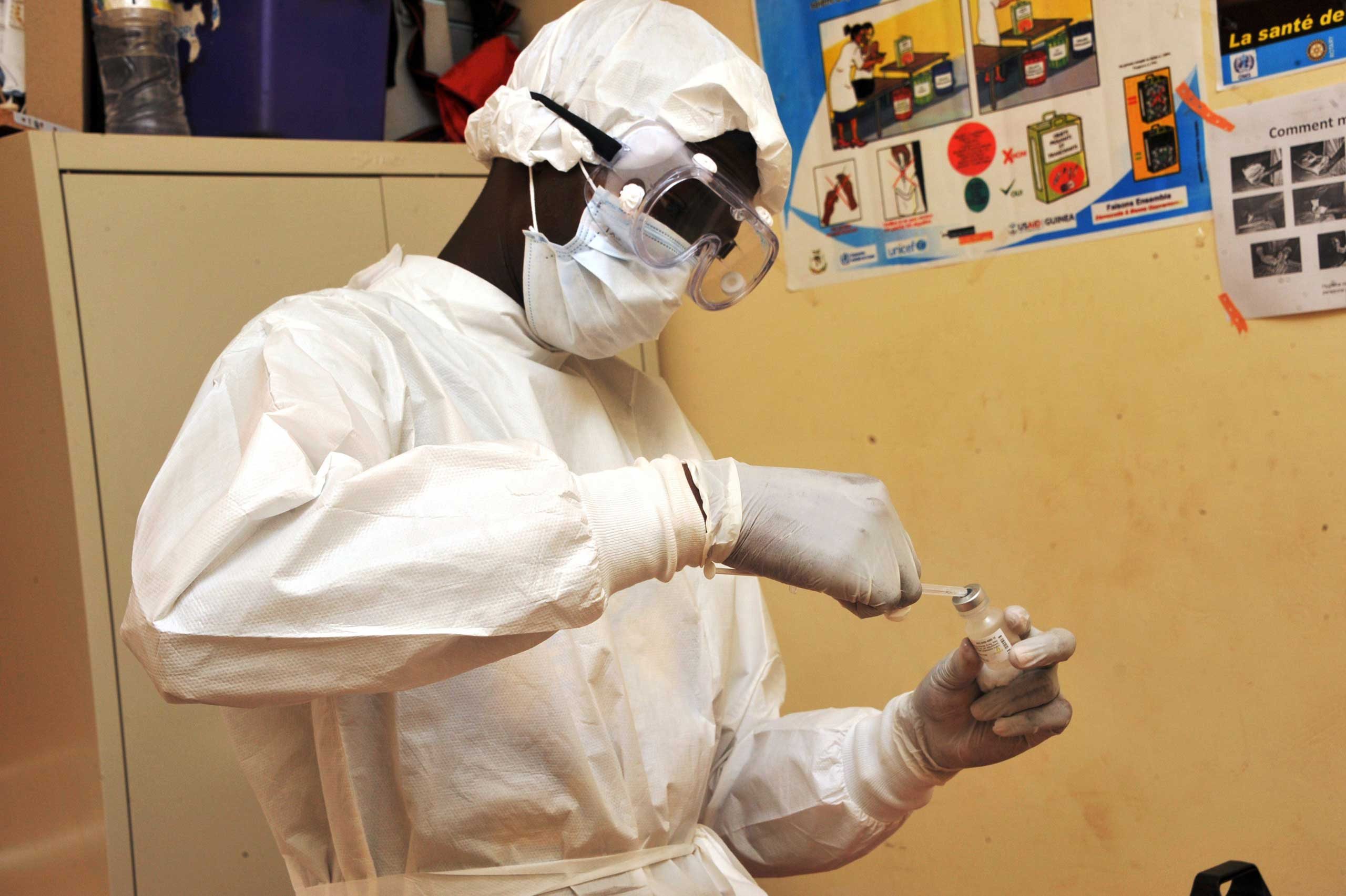 A health worker prepares a vaccination on March 10, 2015 at a health center in Conakry during the first clinical trials of the VSV-EBOV vaccine against the Ebola virus.