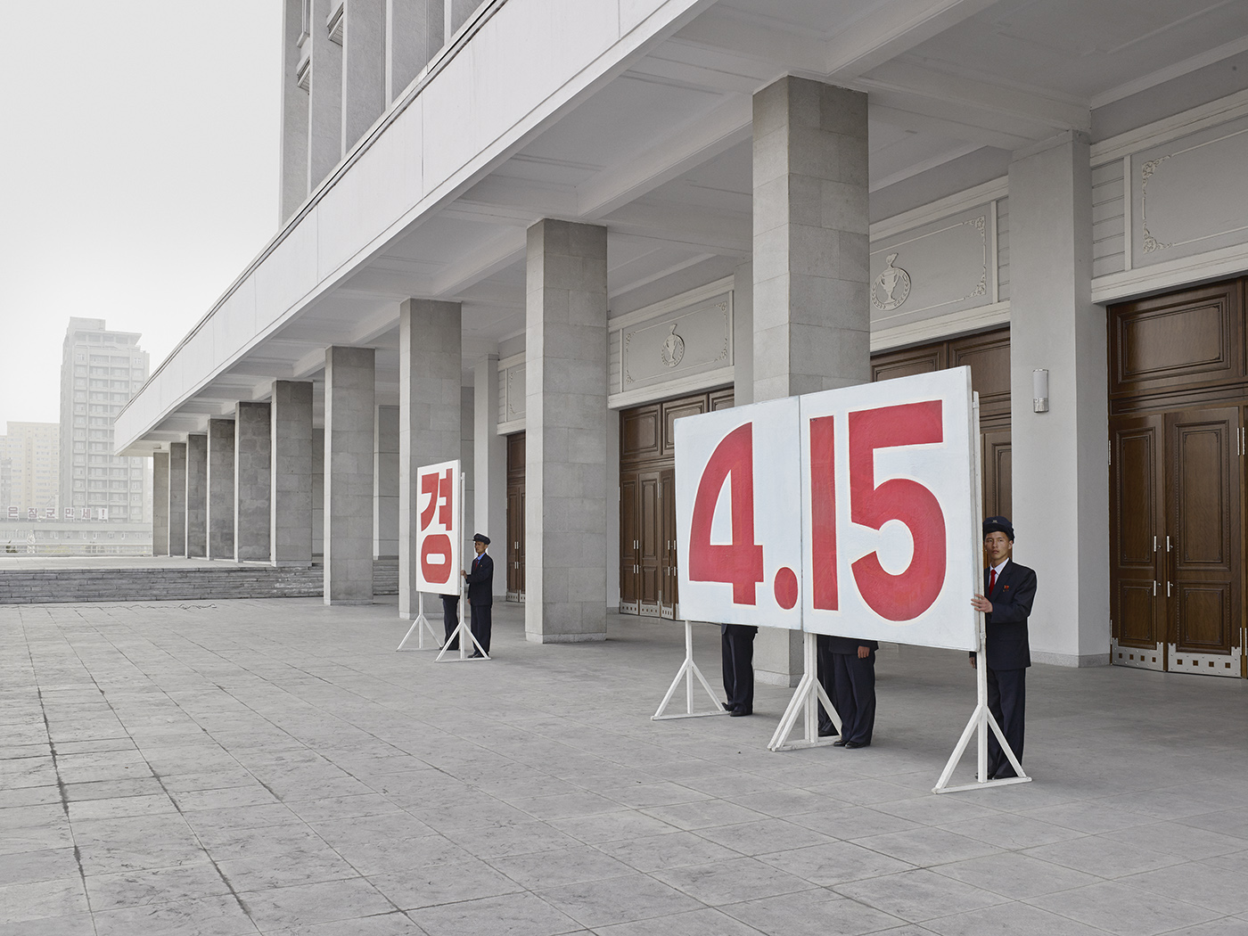 Sings display the date of Kim Il sung's birthday, which is April 15. That date is now a national holiday in North Korea