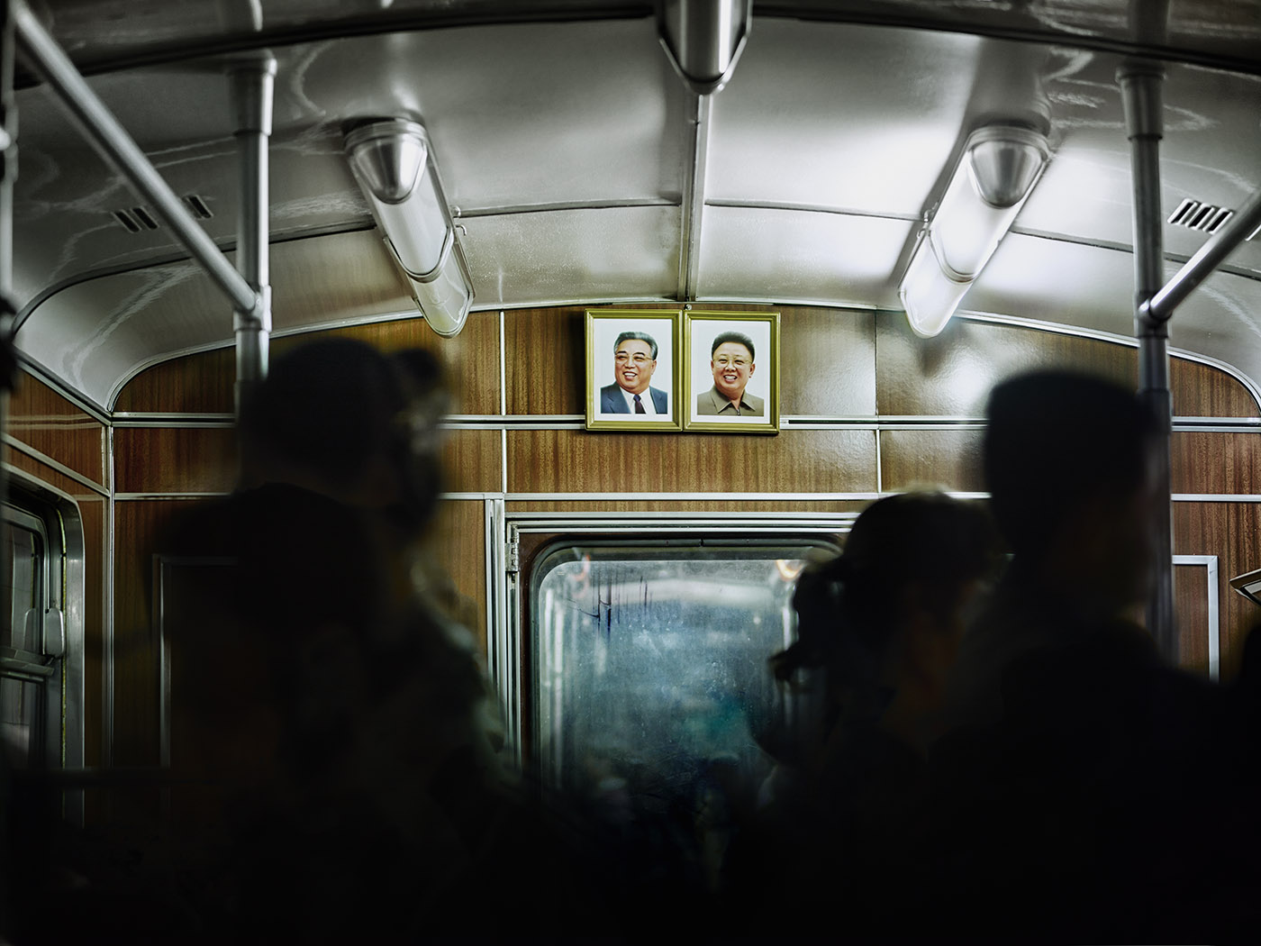 Portraits of the leaders in a Pyongyang Metro car.                                   The Pyongyang Metro opened in 1973 and  currently consists of two lines