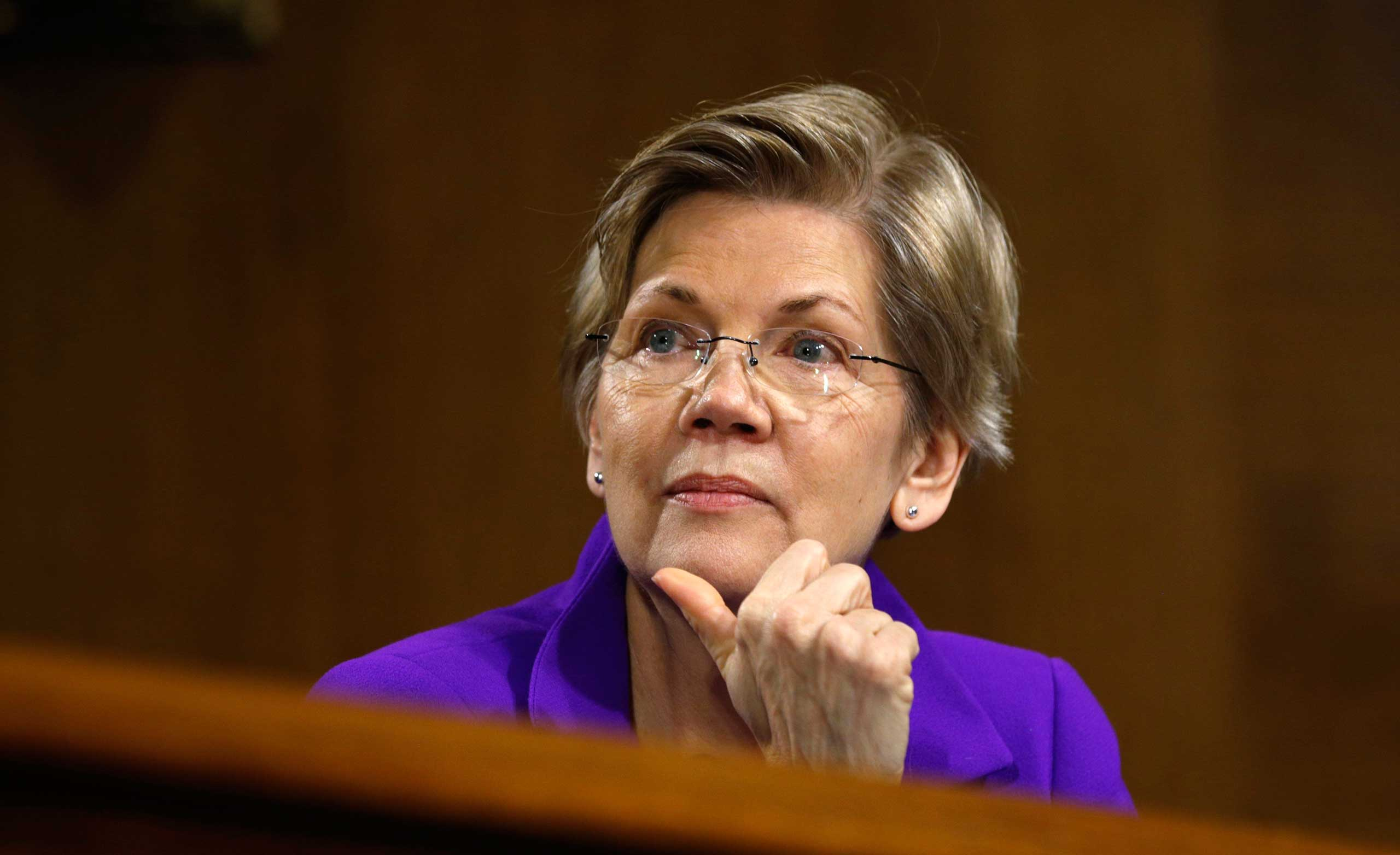 Sen. Elizabeth Warren listens to Federal Reserve Chair Janet Yellen testify during a hearing on Feb. 24, 2015. (Kevin Lamarque—Reuters)