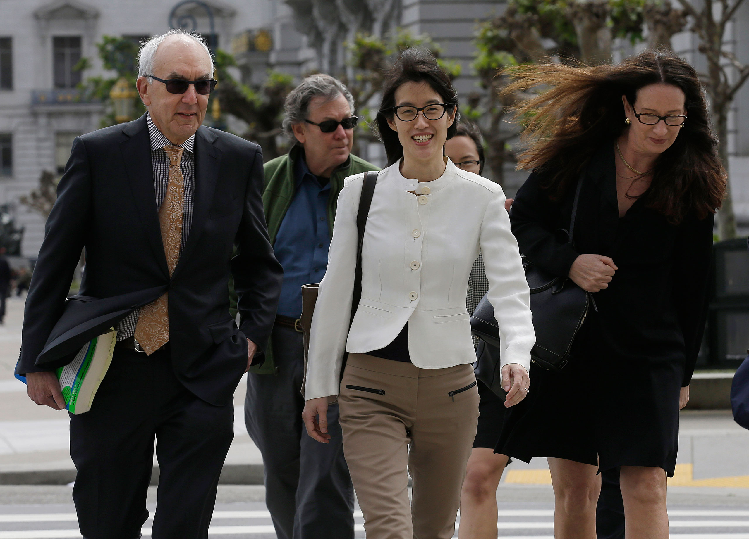 Ellen Pao, center, walks to Civic Center Courthouse in San Francisco, March 27, 2015.