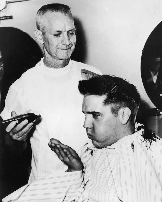 Elvis Presley receiving a haircut from a US Army barber at Fort Chaffee, Ark., in 1958