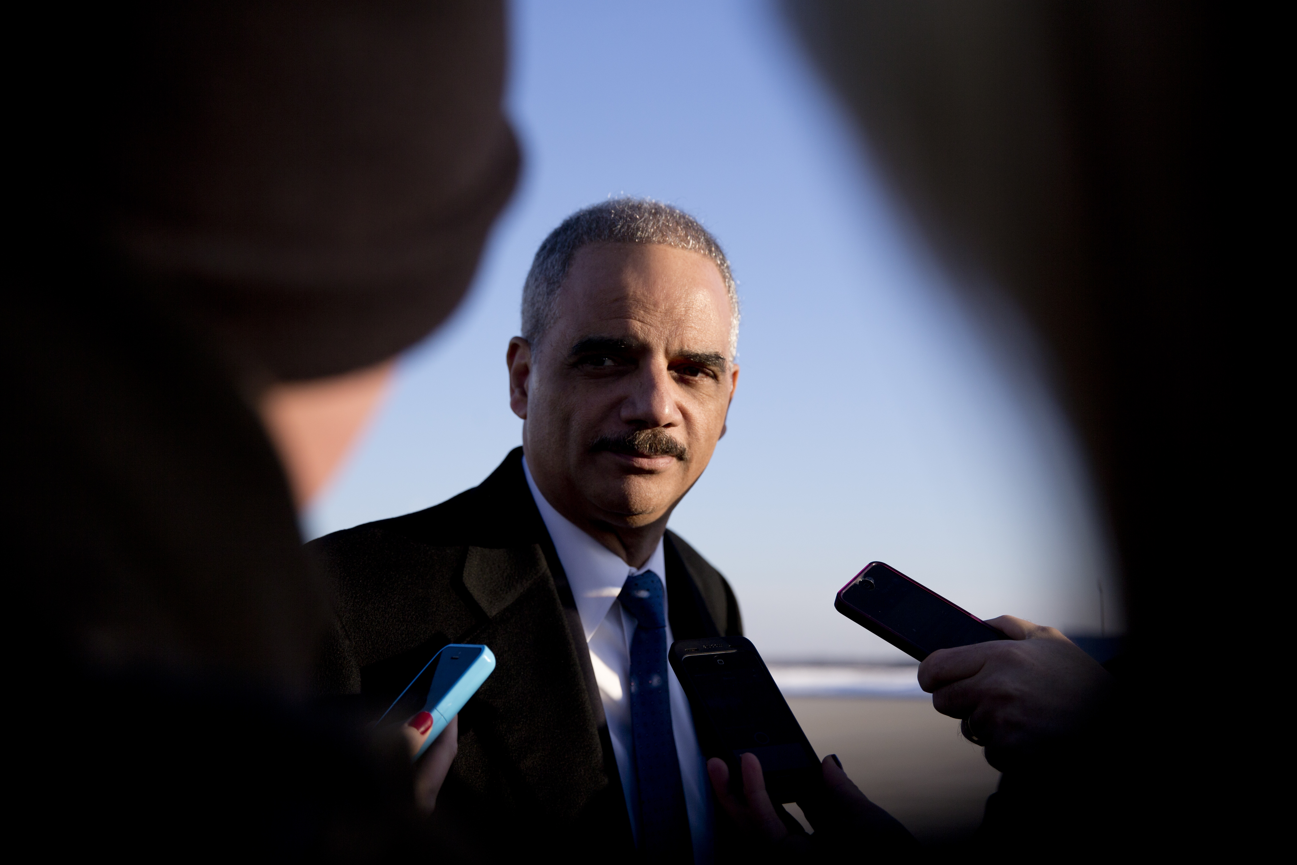 Attorney General Eric Holder talks with media as he arrives on Air Force One in Andrews Air Force Base, Md. on March 6, 2015, with President Barack Obama, from Columbia, S.C.