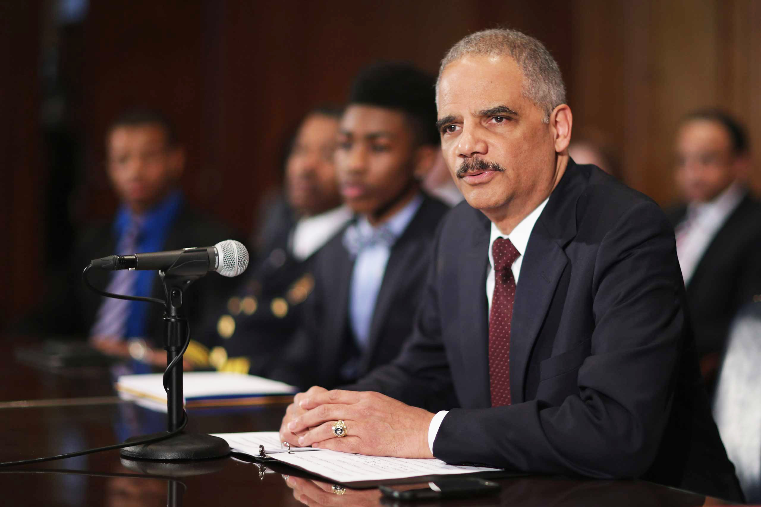 U.S. Attorney General Eric Holder delivers remarks about the shooting of two police officers in Ferguson, Mo., while announcing the first six pilot sites for the National Initiative for Building Community Trust and Justice at the Department of Justice in Washington, D.C., on March 12, 2015