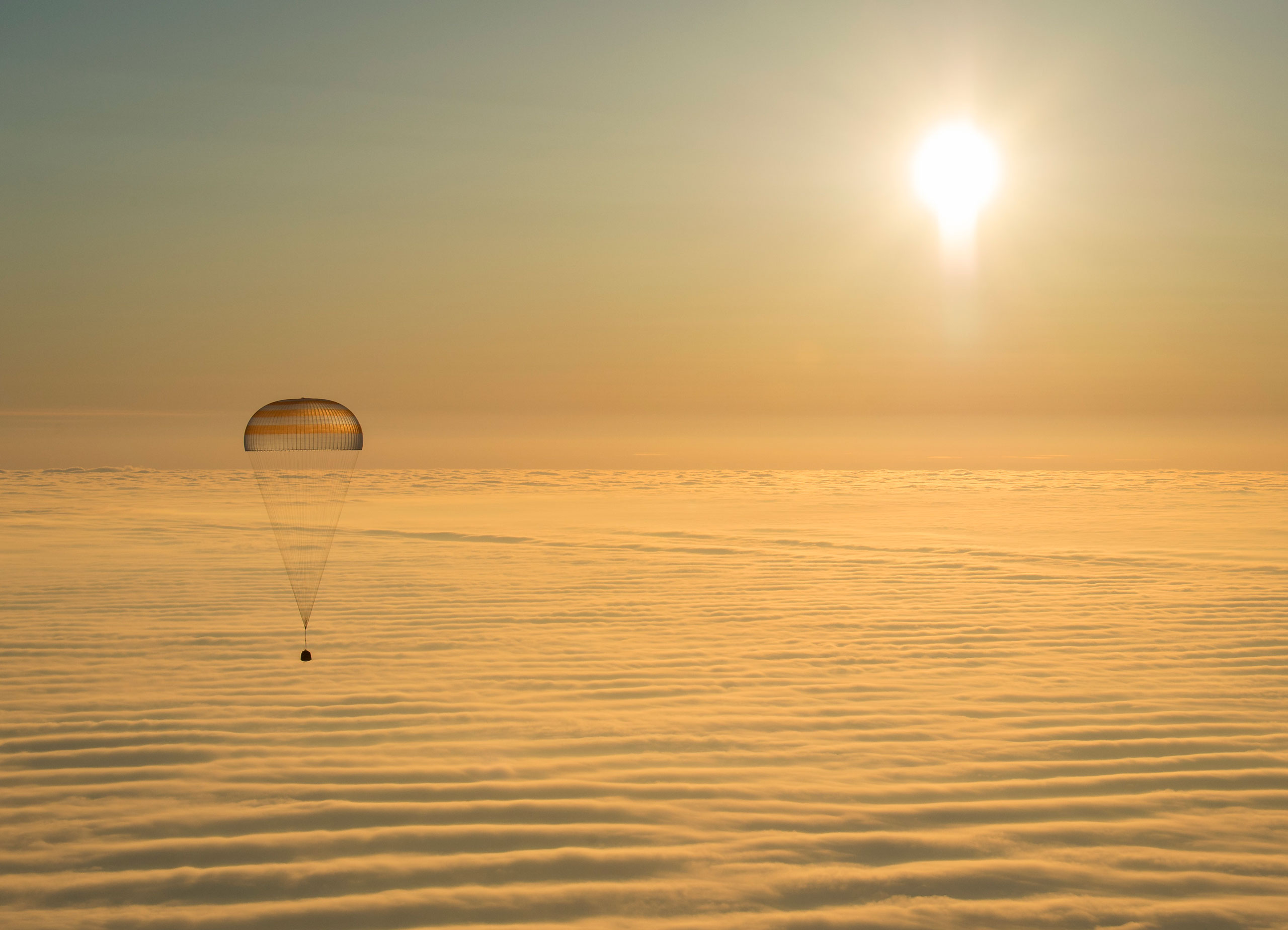 The Soyuz TMA-14M spacecraft as it lands with Expedition 42 commander Barry Wilmore of NASA, Alexander Samokutyaev of the Russian Federal Space Agency (Roscosmos) and Elena Serova of Roscosmos near the town of Zhezkazgan, Kazakhstan on March 12, 2015.