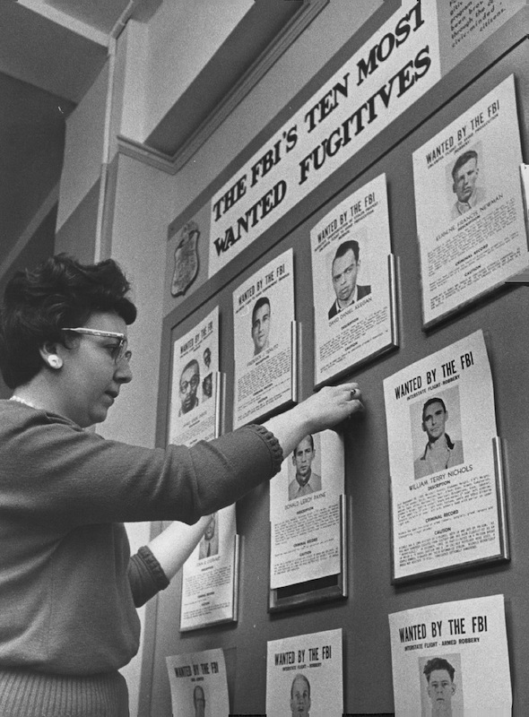 Receptionist Betty Porco keeps the 10 Most Wanted pictures straight in the Denver FBI office in 1962