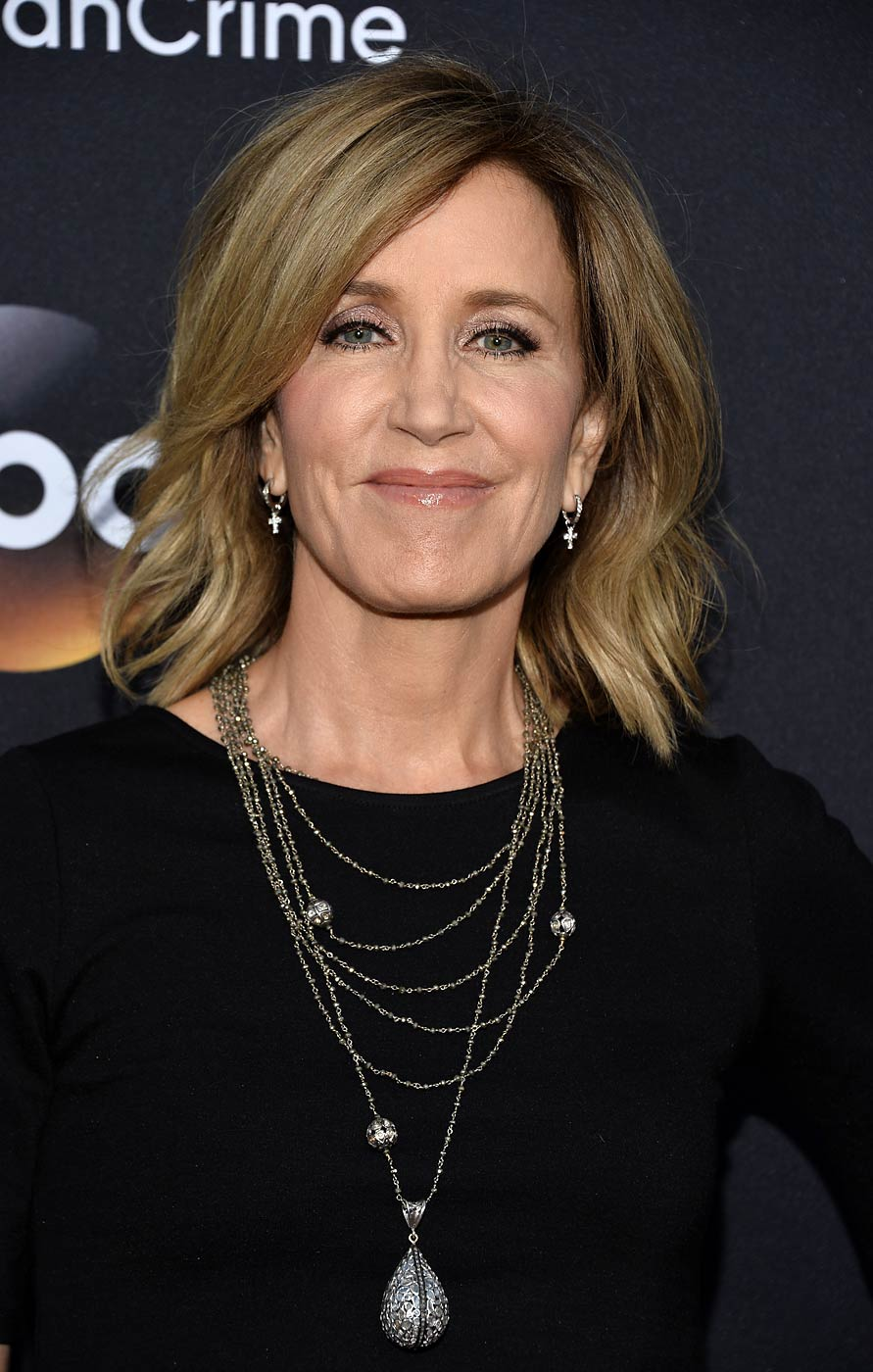 Felicity Huffman arrives at the American Crime premiere at the Ace Hotel on Feb. 28, 2015 in Los Angeles, Calif.