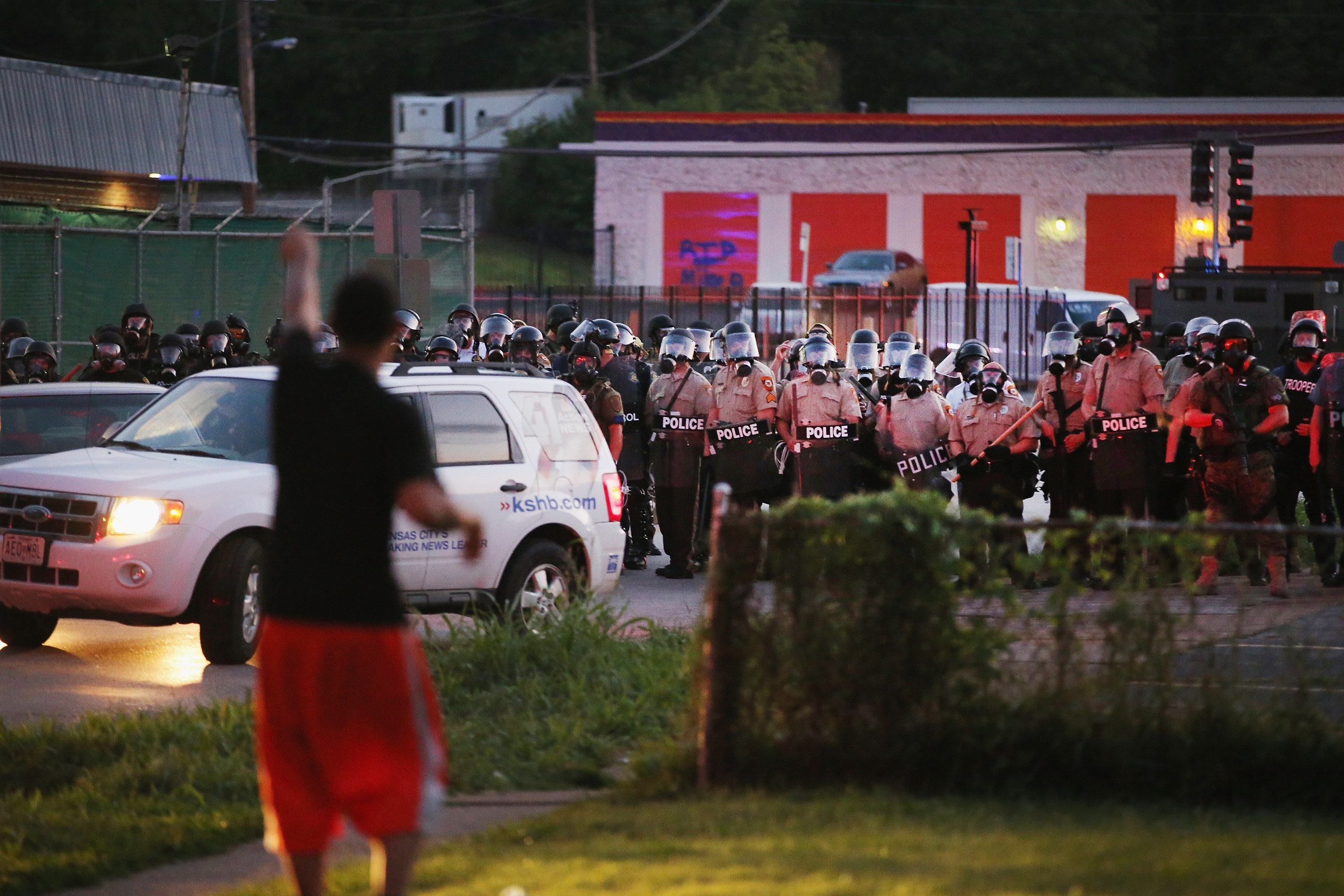 Riot police force protestors from the business district into nearby neighborhoods in Ferguson, Mo. on Aug. 11, 2014.