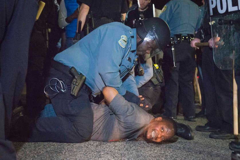 Police arrests a protestor outside the City of Ferguson Police Department and Municipal Court in Ferguson, March 11, 2015.