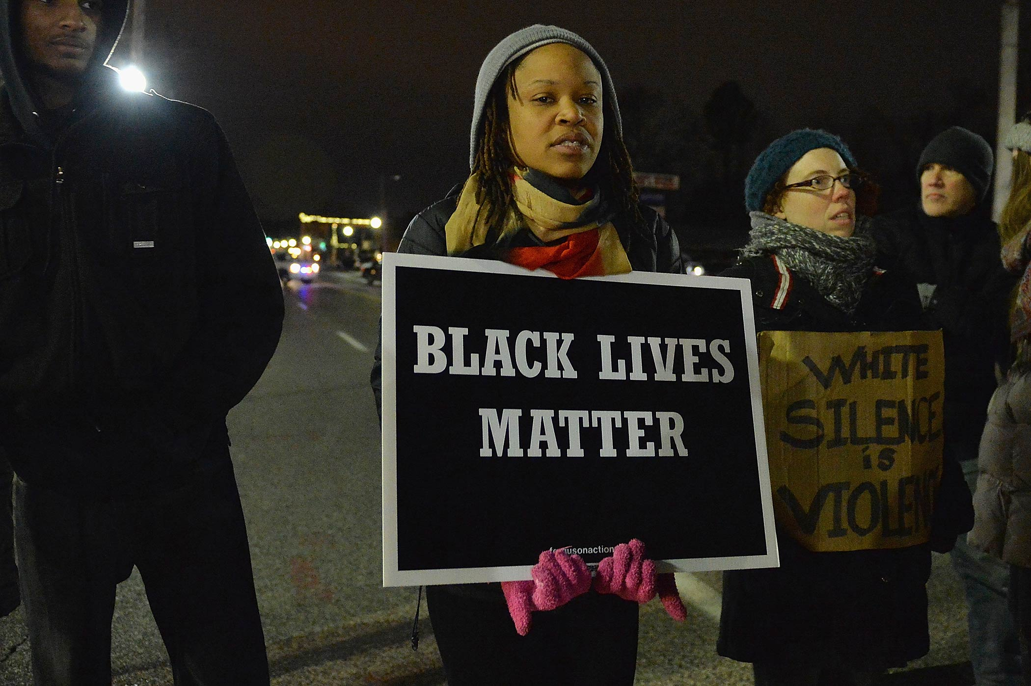 Protestors demonstrate outside the Ferguson Police Department in Ferguson, Mo. on March 4, 2015.