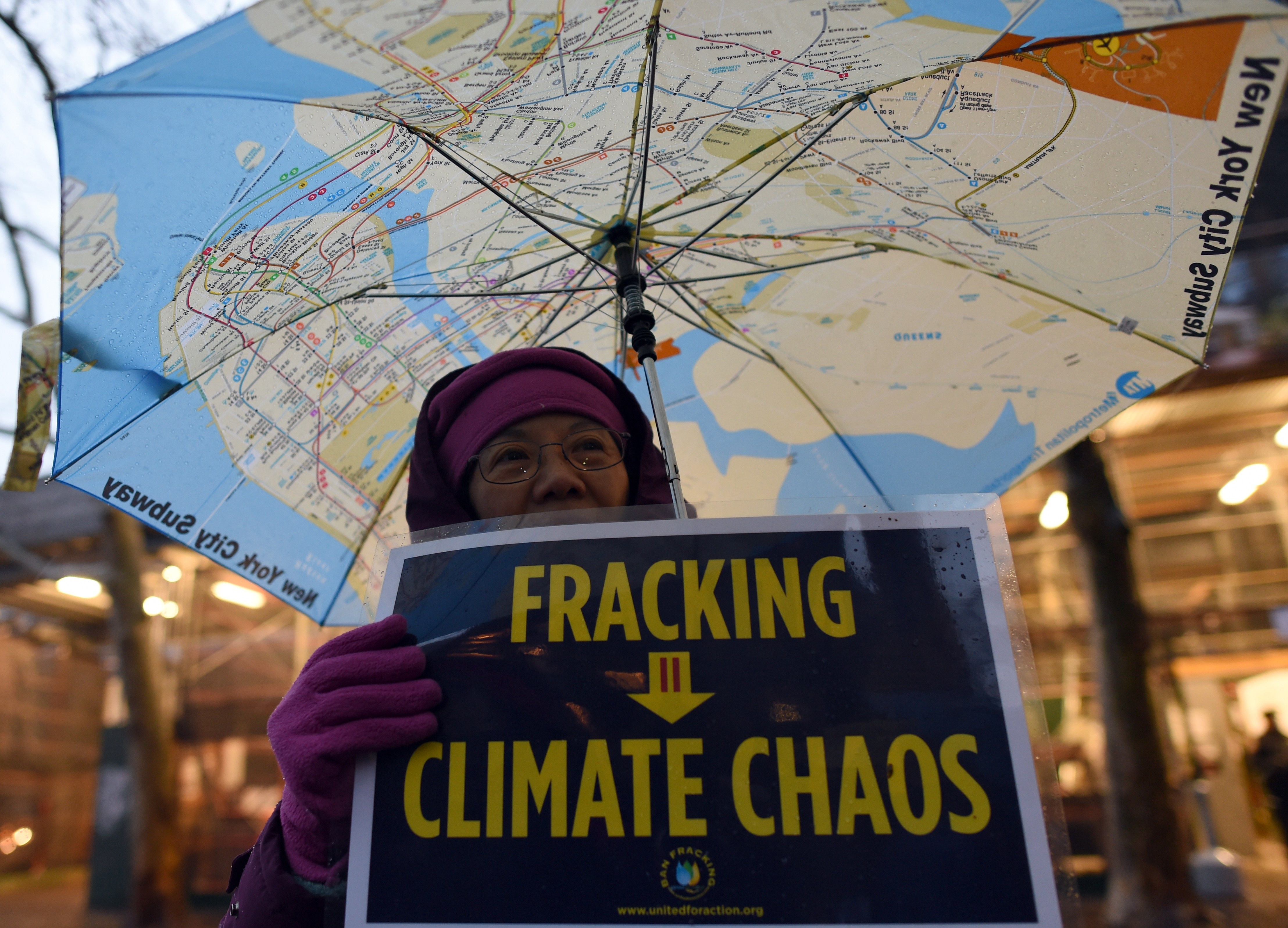 A woman holds an anti-fracking sign as a group of demonstrators gather for a rally for a Global Climate Treaty on Dec. 10, 2014 in New York City.