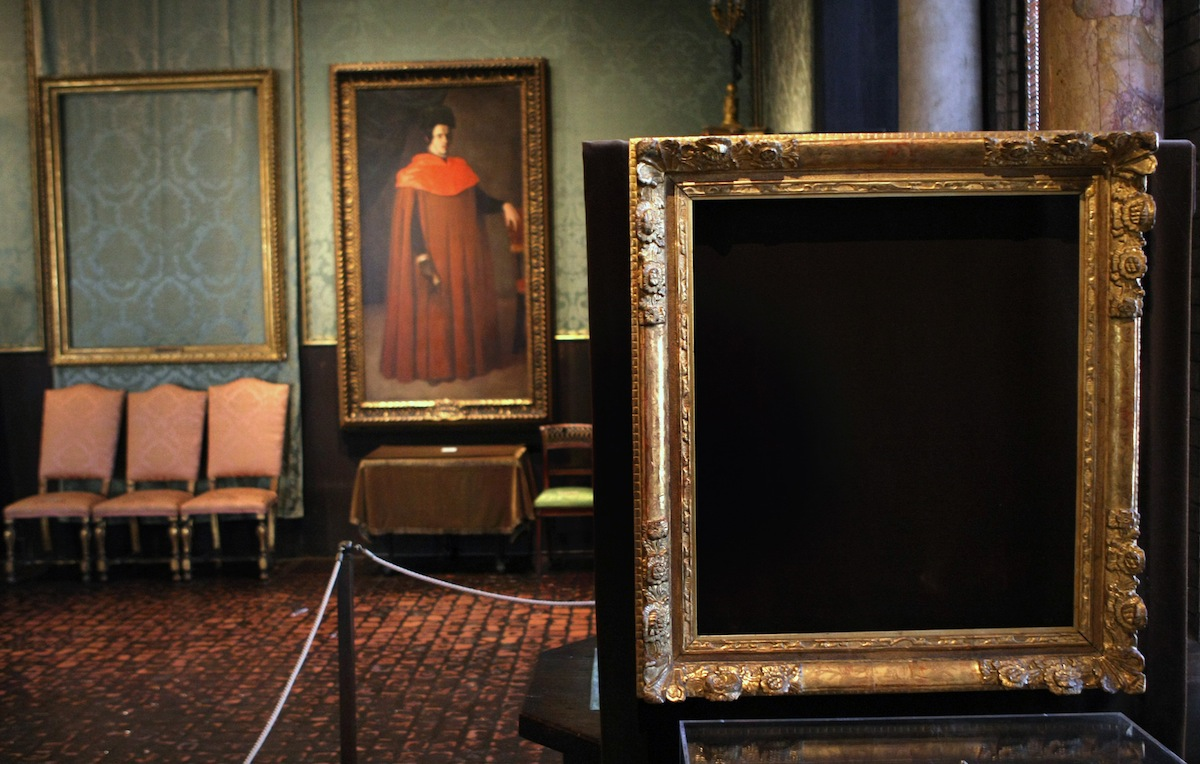 An empty frame on the right is where Vermeer's  The Concert,  circa 1658 - 166, once was.