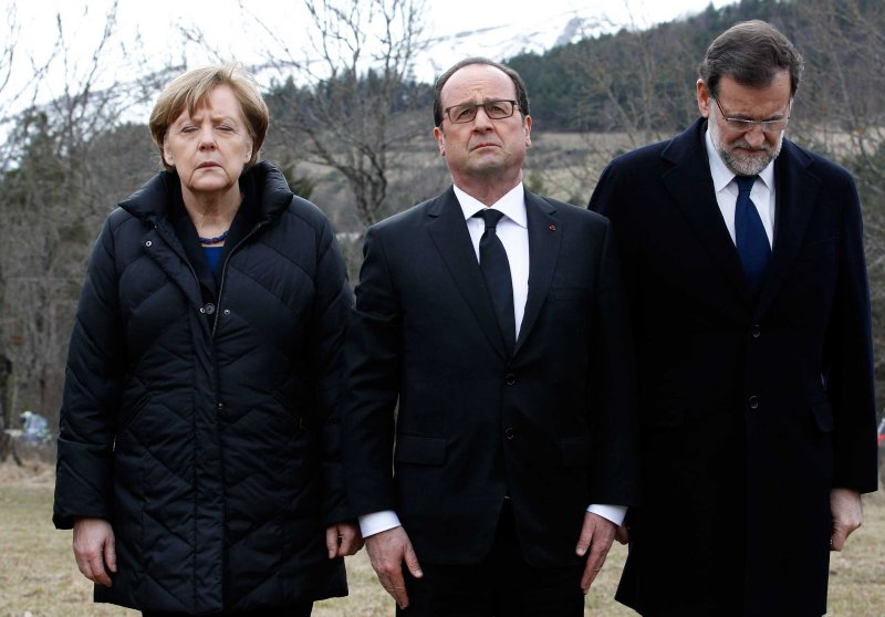 German Chancellor Angela Merkel, French President Francois Hollande, and Spanish Prime Minister Mariano Rajoy pay respect to victims in front of the mountain where a Germanwings jetliner crashed in Le Vernet, France, March 25, 2015.