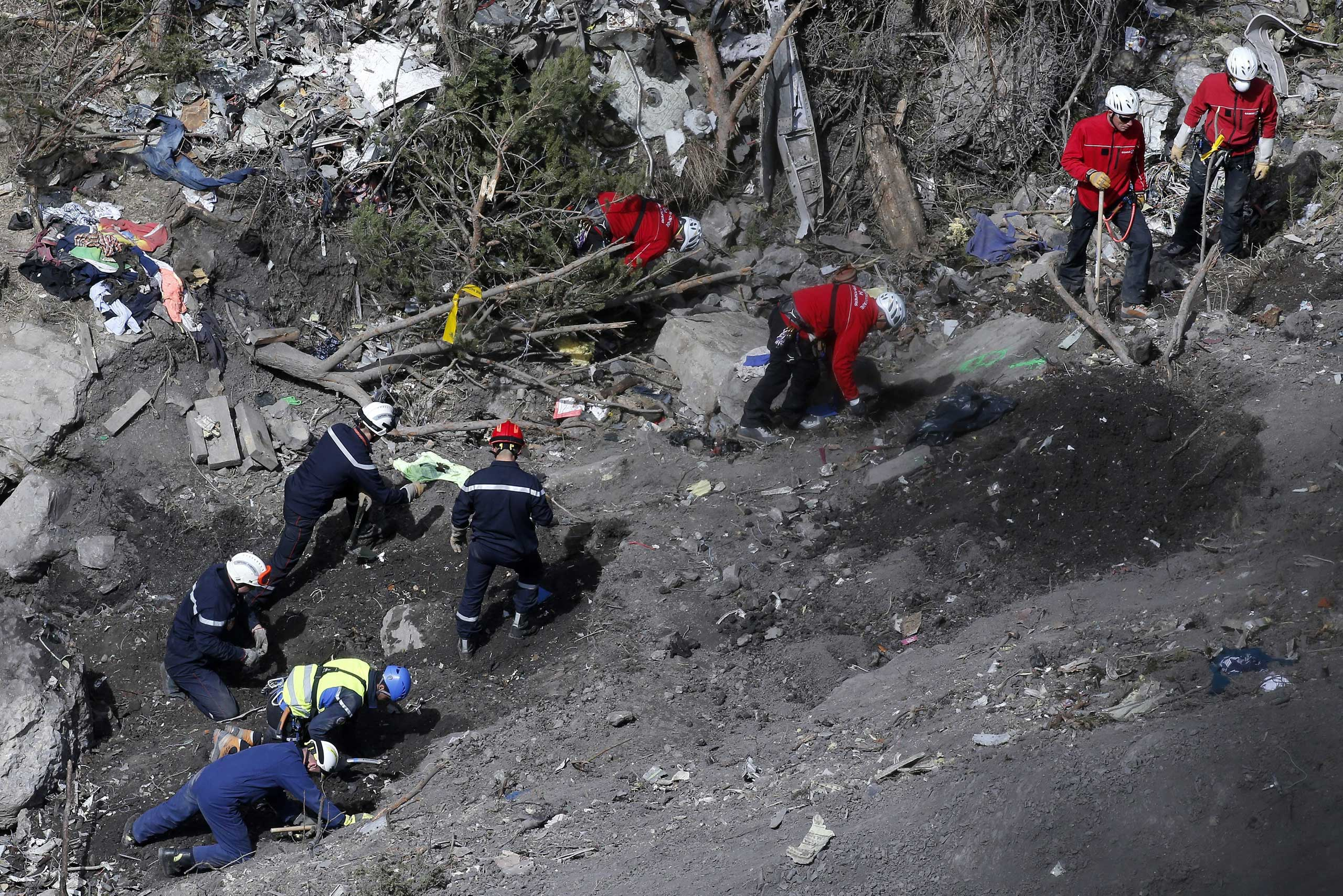 Searchers work to collect debris and find the second black box resume at the crash site of the Germanwings Airbus A320 in the French Alps, above the town of Seyne-les-Alpes, southeastern France, March 29, 2015.