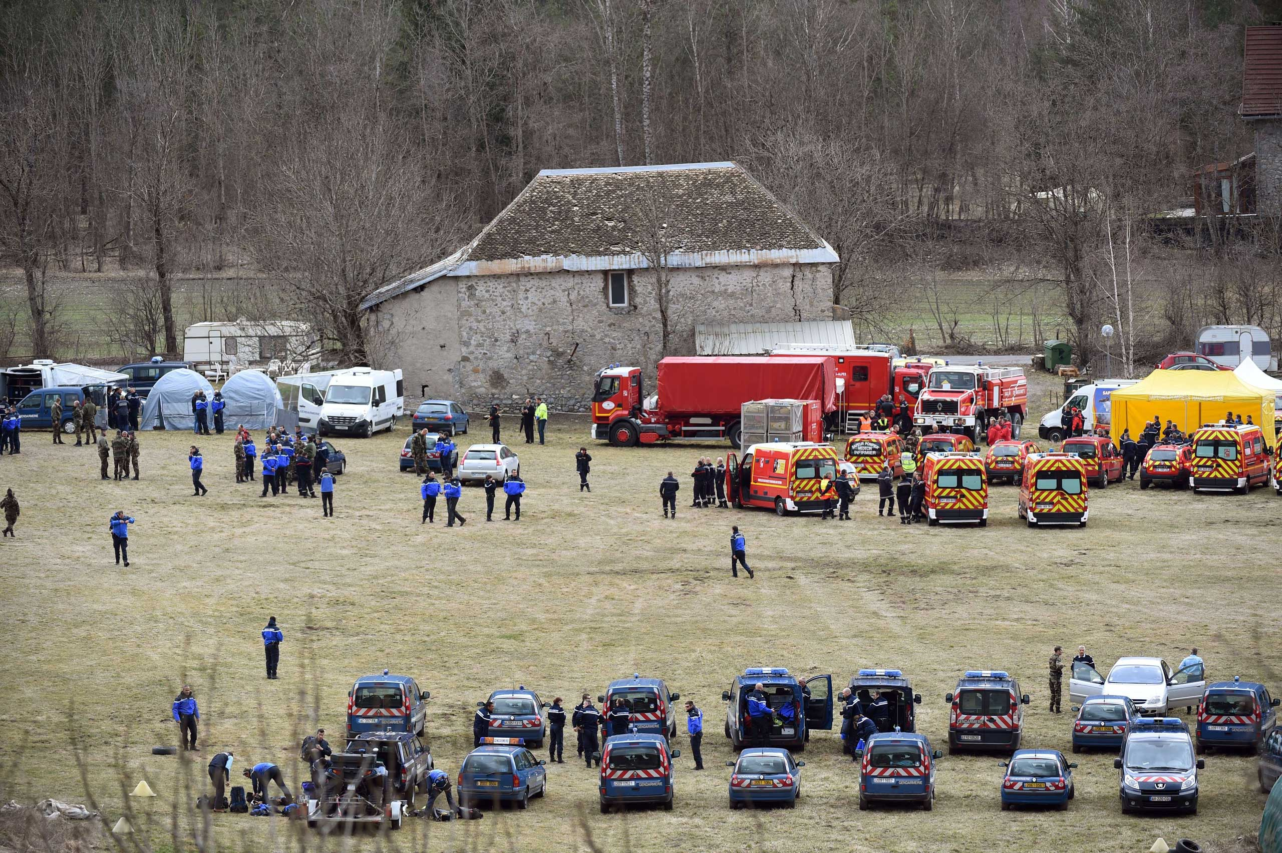 French emergency services workers and members of the French gendarmerie gather in Seyne, south-eastern France, on March 24, 2015, near the site where a Germanwings Airbus A320 crashed in the French Alps.