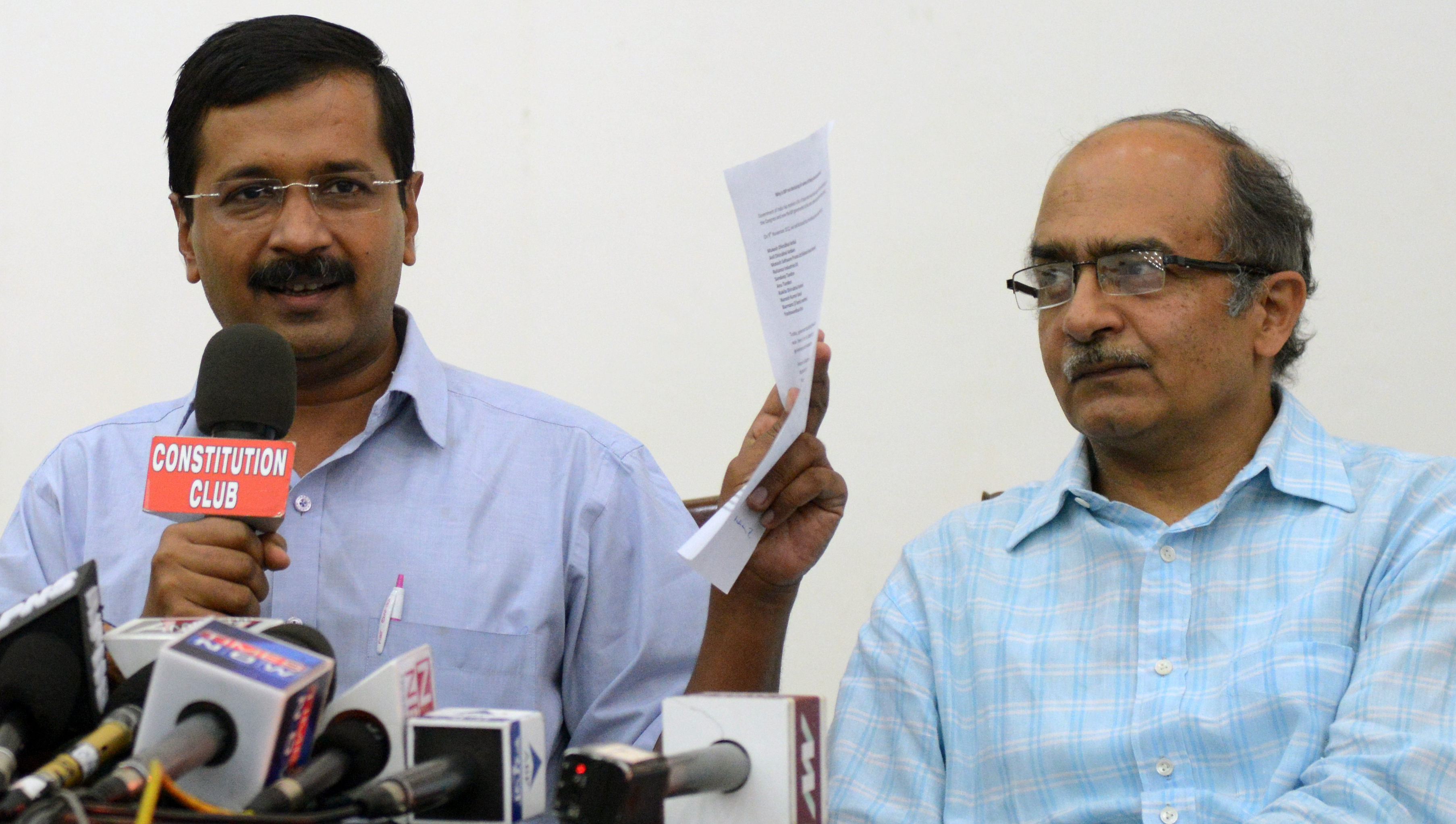 Aam Aadmi Party convener Arvind Kejriwal and Prashant Bhushan addressing the media in New Delhi