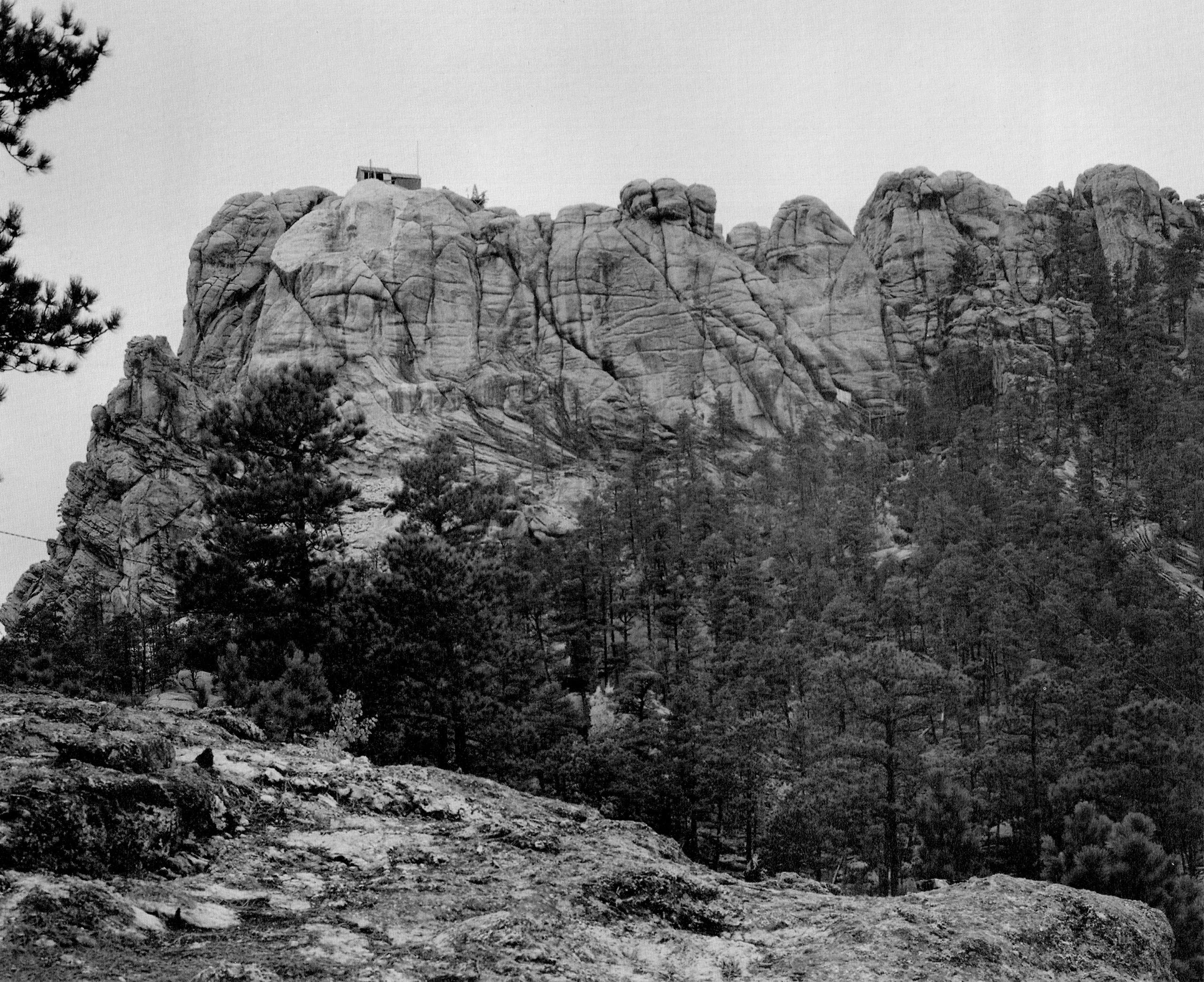 Mount Rushmore with the face of George Washington first beginning to appear (top left), c. 1930s.
