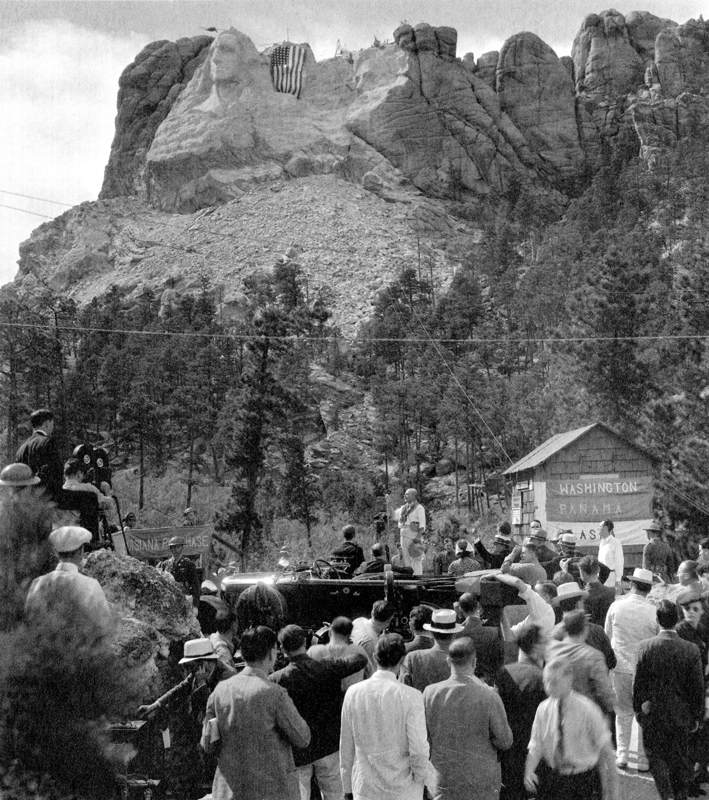 Gutzon Borglum addresses President Franklin D. Roosevelt (seated in the presidential car) and the crowd at the dedication of Thomas Jefferson on Aug. 30, 1936.
