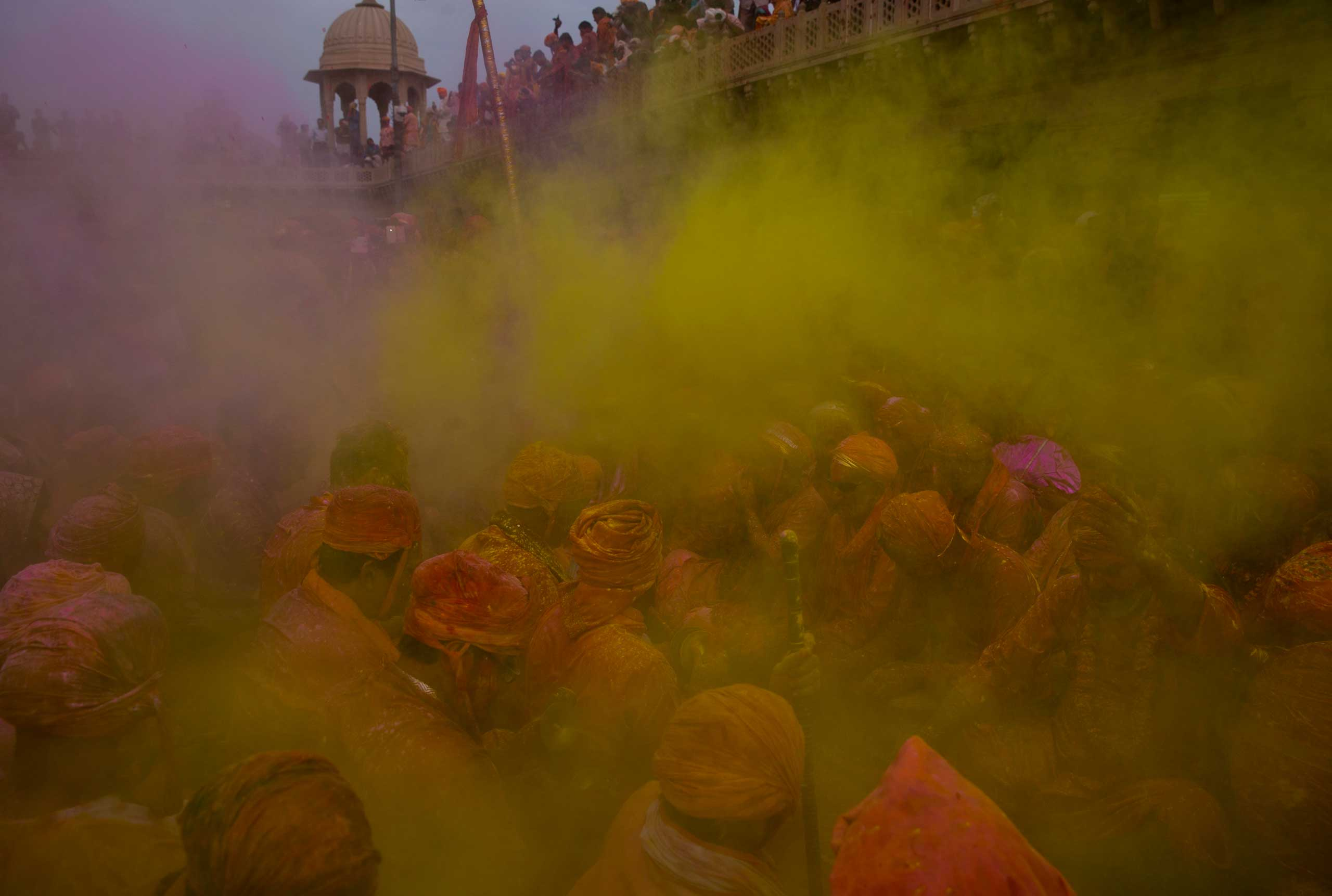 Indian Hindu devotees smeared with colors, sing songs at the Nandagram temple famous for Lord Krishna and his brother Balram, during Lathmar holi festival, in Nandgaon, India, Feb. 28, 2015.