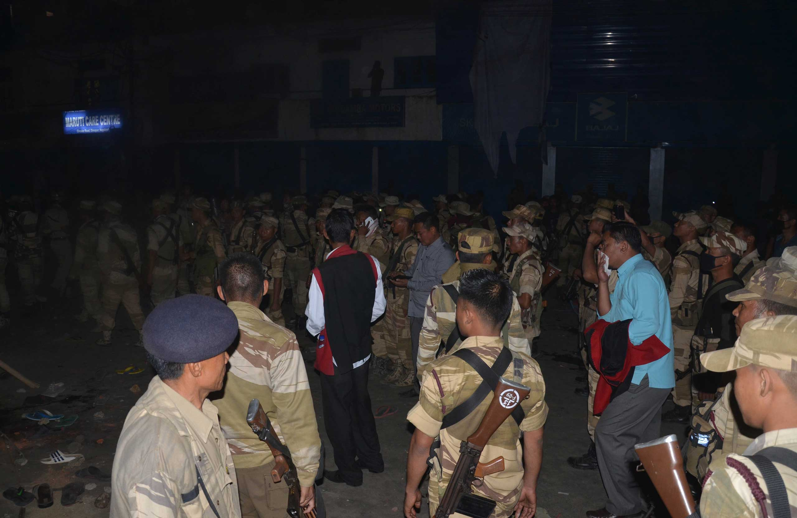Security personnel clear the crowd after the mob killed accused rapist Syed Farid Khan, Dimapur, India, March 5, 2015.
