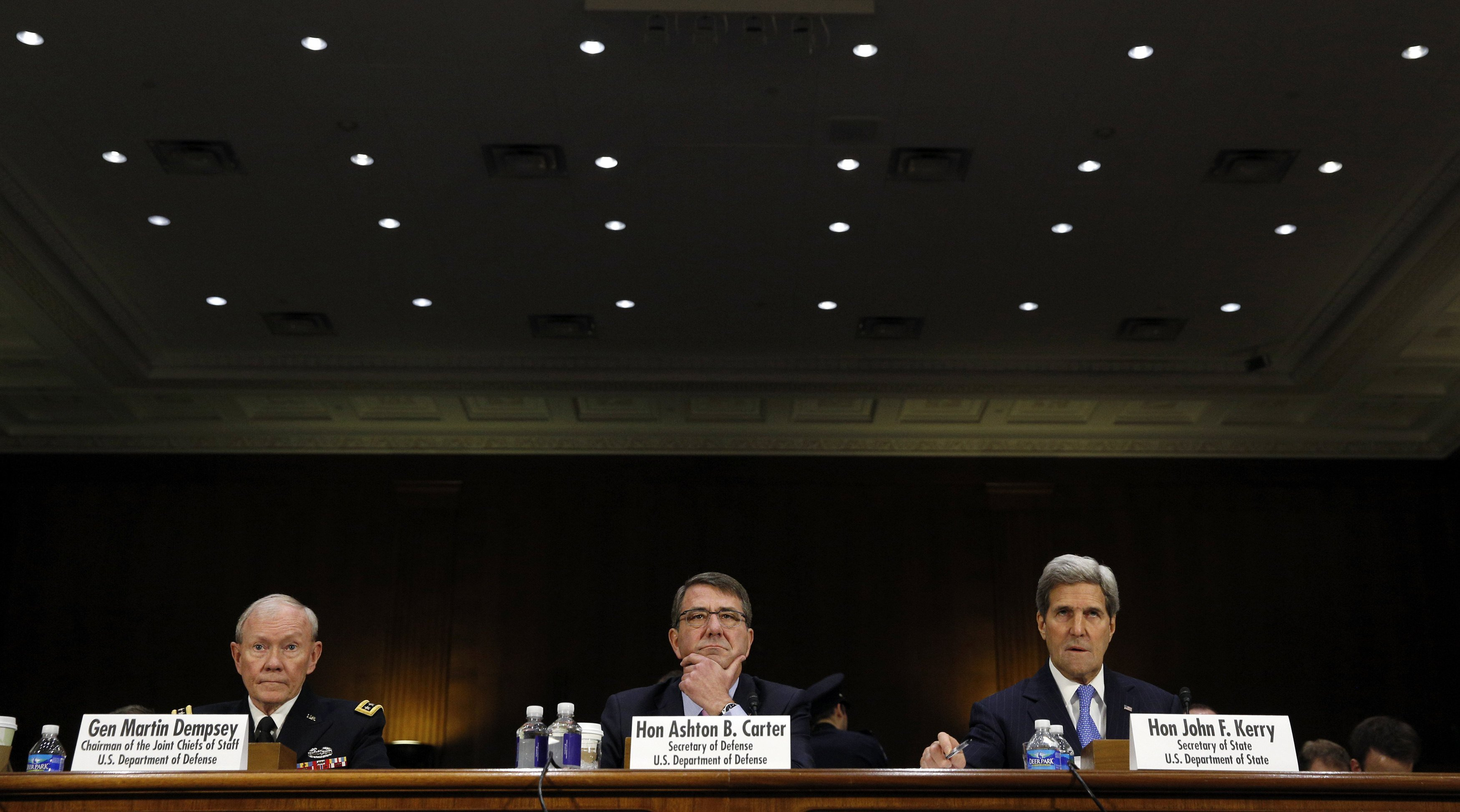 Joint Chiefs of Staff Chairman Army Gen. Martin Dempsey (L), U.S. Defense Secretary Ash Carter (C) and Secretary of State John Kerry testify at a Senate Foreign Relations Committee hearing on  The President's Request for Authorization to Use Force Against ISIS: Military and Diplomatic Efforts                    on Capitol Hill in Washington on March 11, 2015.