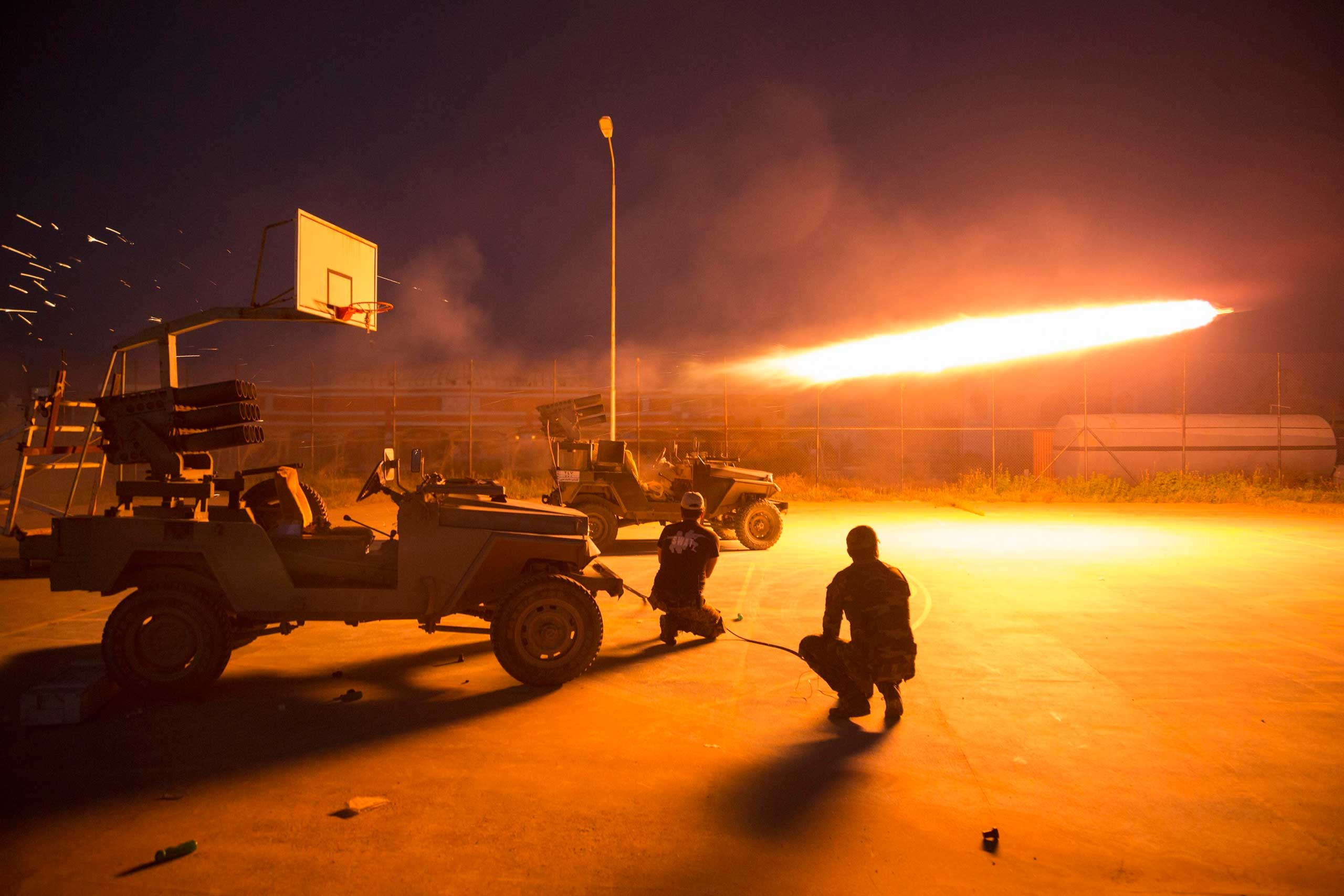 Shi'ite fighters fire a rocket during clashes with ISIS militants in Salahuddin province, March 1, 2015.
