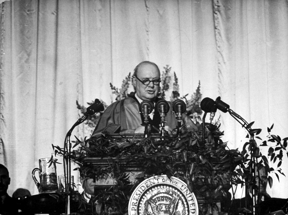 British Prime Minister Winston Churchill delivers a speech at Westminster College that addressed the Communist threat, and in which he uttered the now-famous phrase 'Iron Curtain,' Fulton, Mo., Mar. 5, 1946.